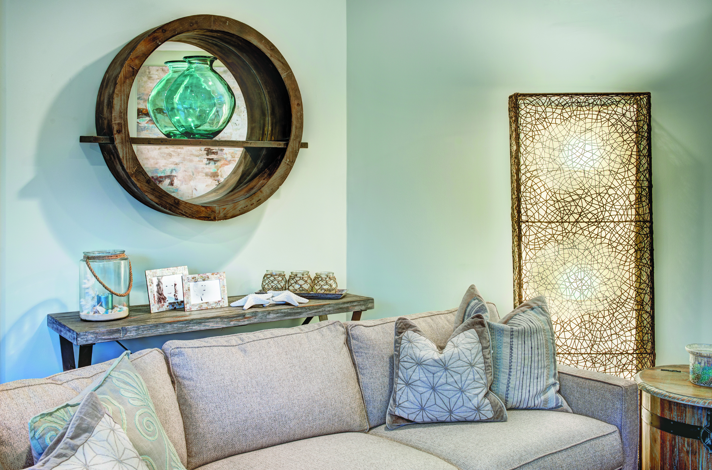 Lighting and mixed accent pieces create a warm and inviting family room.