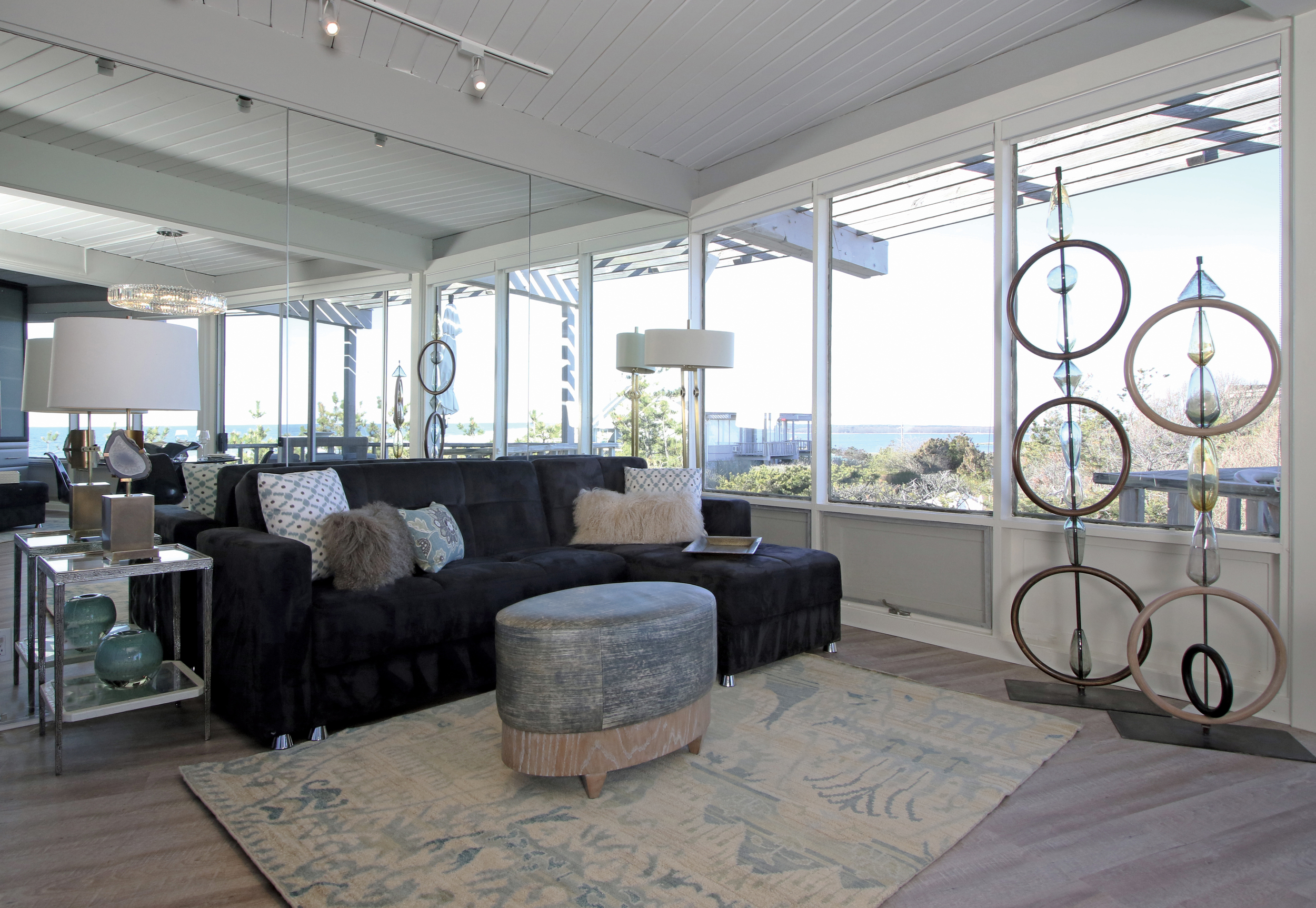 Sofa seating area with view of the bay by day opens to a guest bed by night.