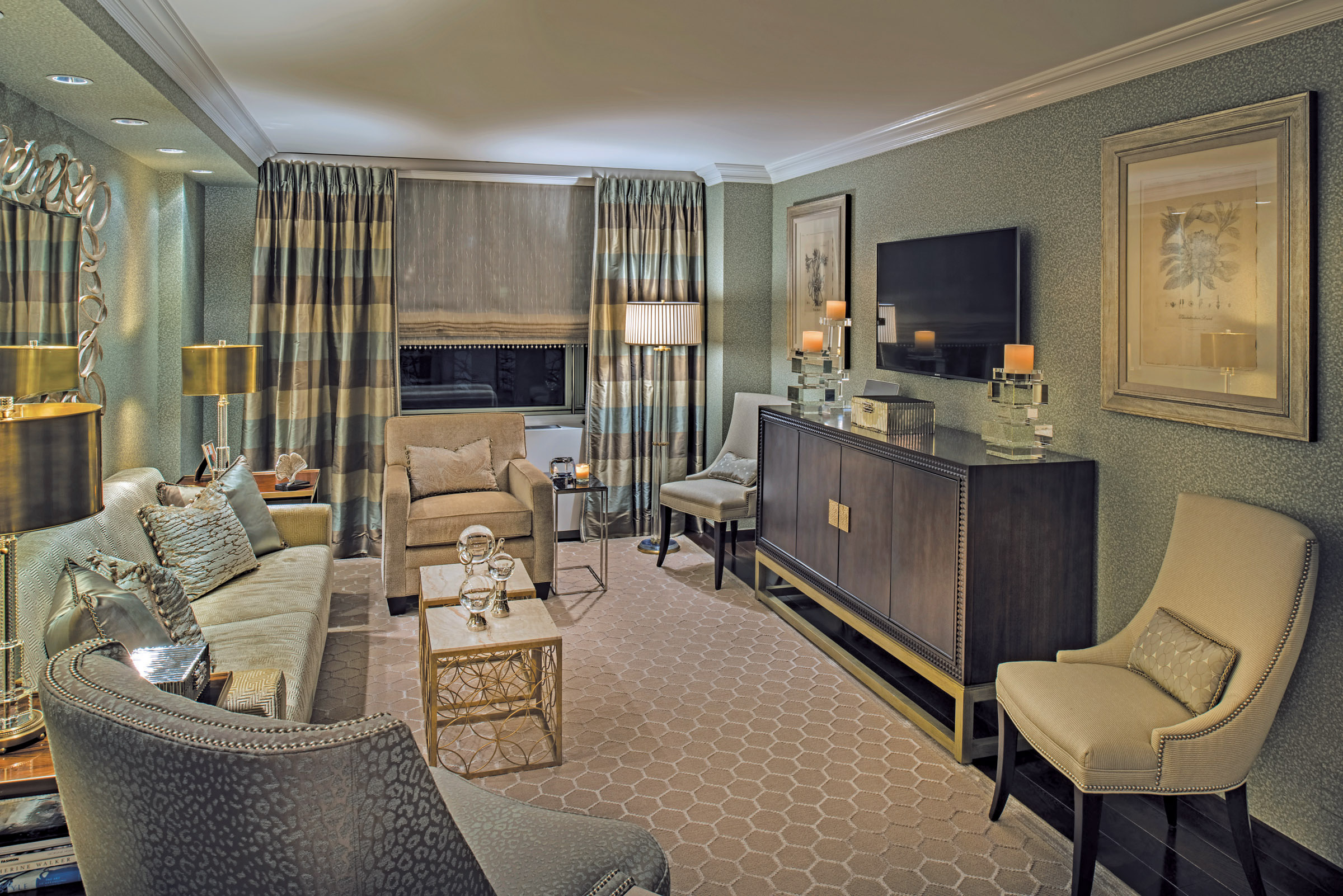 Kravet fabrics in the living room enhance upholstery by Louis J. Solomon. Lucite lamps project soft, romantic lighting.