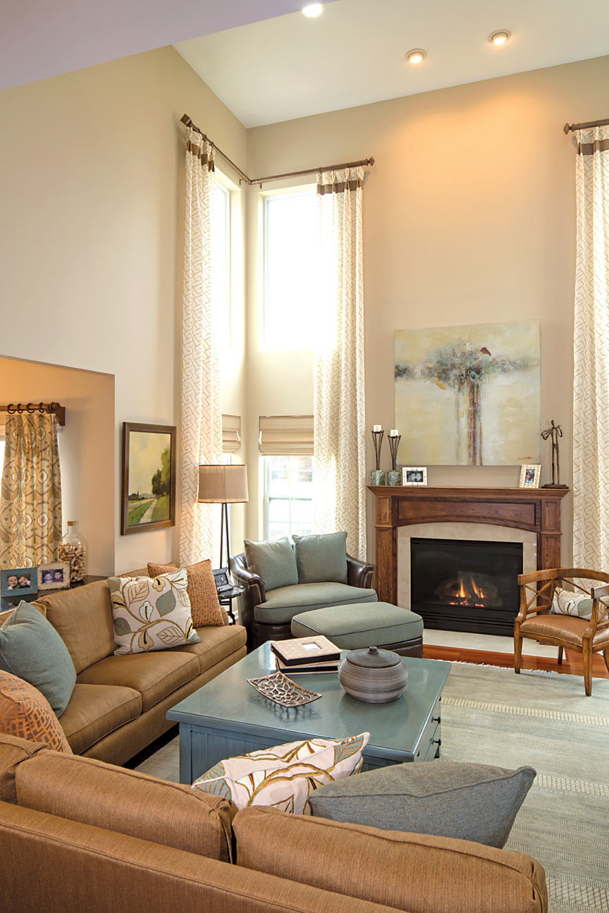 Dramatic great room yet warm and inviting. Generous sofas from Hickory White and a chair and a half from John Richard offers ample seating for friends and family.