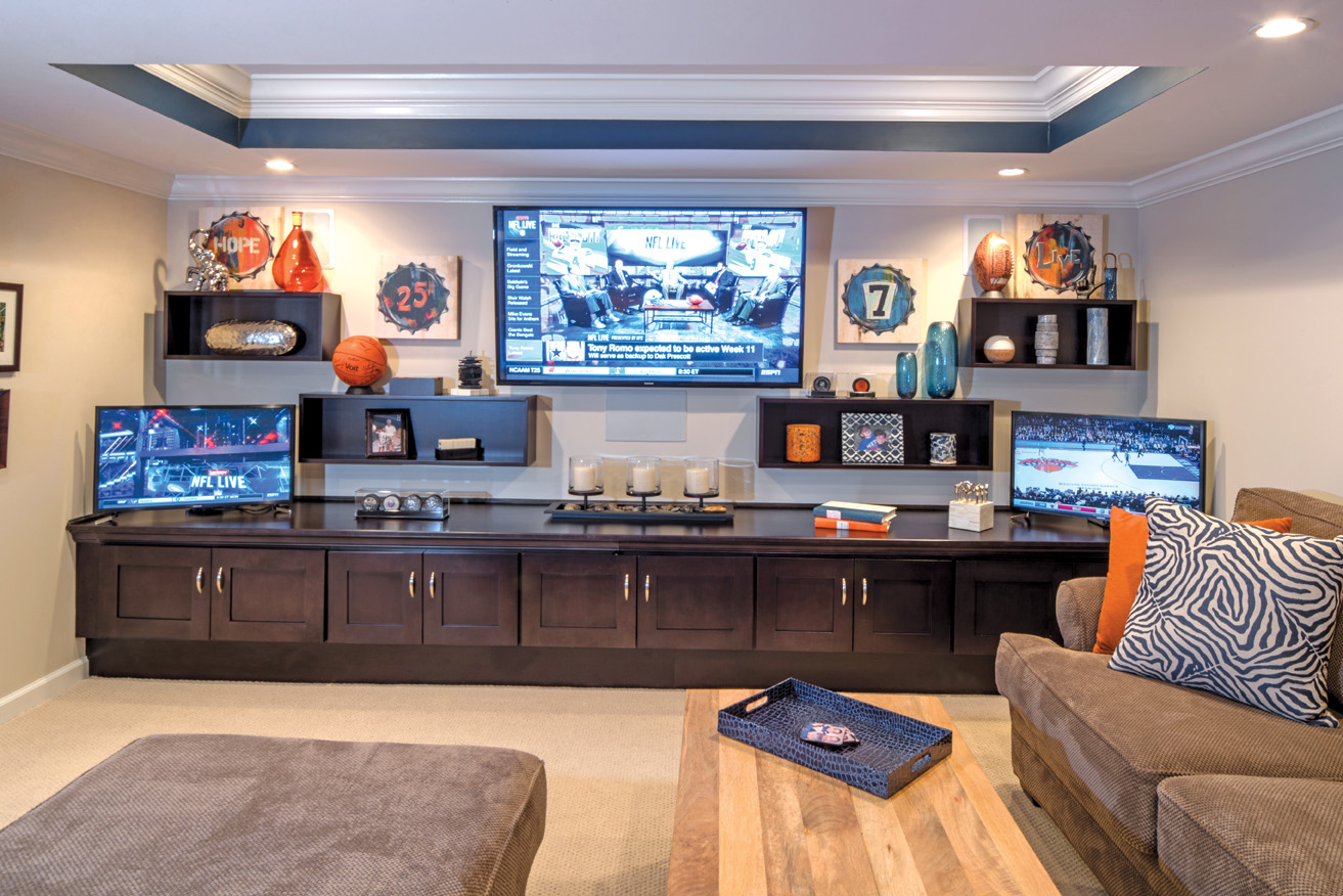 Ultimate custom multi-media room lets family and friends enjoy their sporting events in luxury with a side game of shuffleboard.