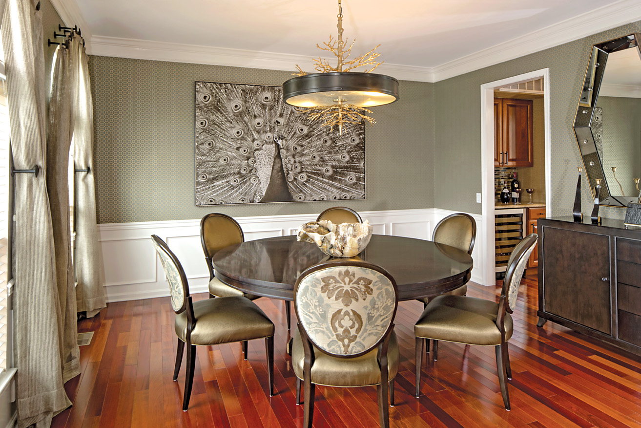 Elegant and welcoming dining room. Textured wallcovering coordinates with metallic leather chair seats; perfect for practical living with style.