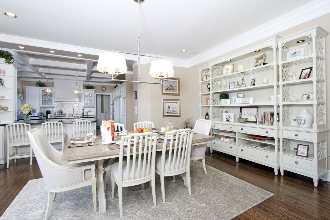 The kitchen/eating area looking out on the backyard and pool was designed with practicality in mind incorporating a casual wood table top, easy to clean chair seats and rug and plenty of space for highchair and riding toys.