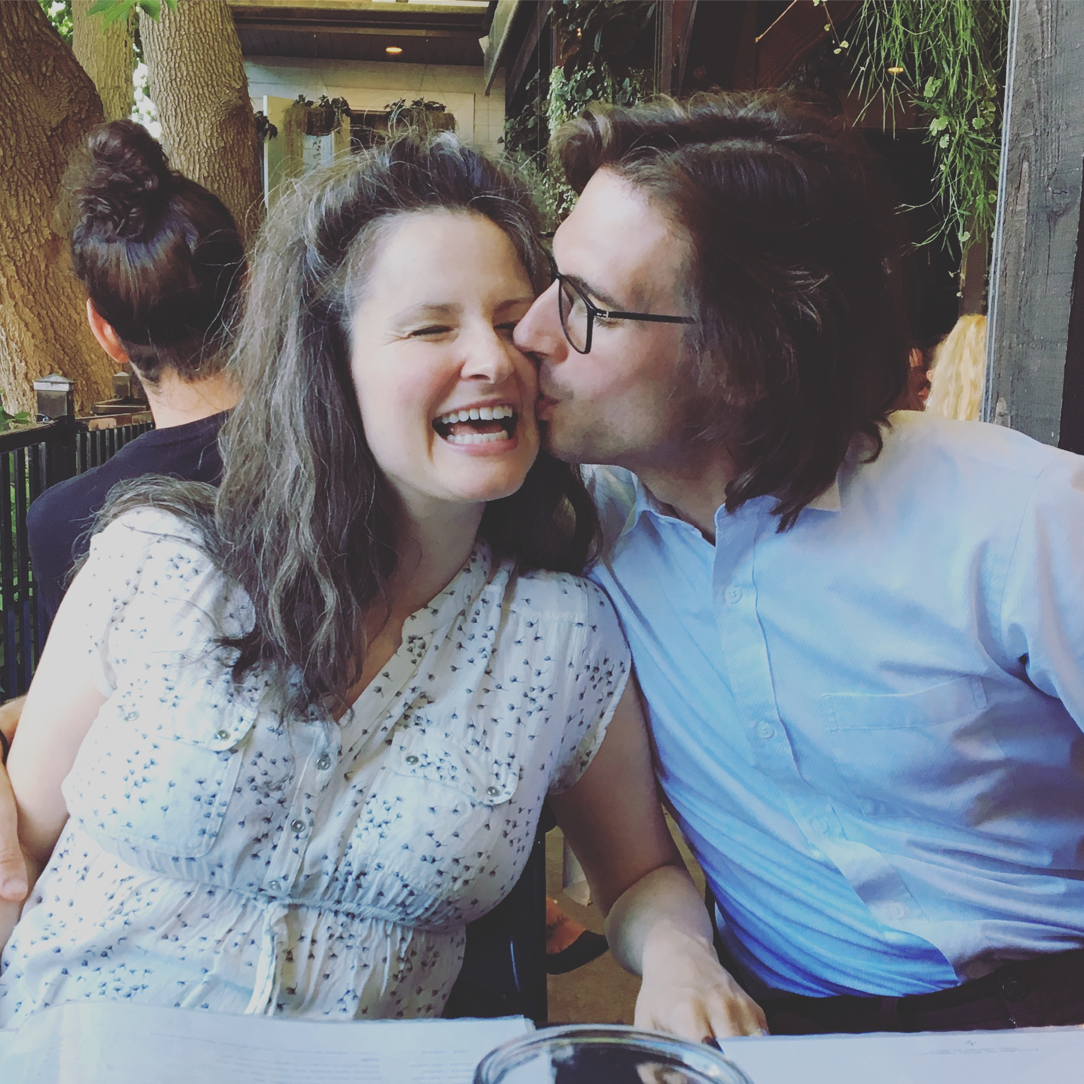 Mat and I celebrated our 4th wedding anniversary this summer! Mom took us out to dinner and let us sit on the same side of the table. :D
