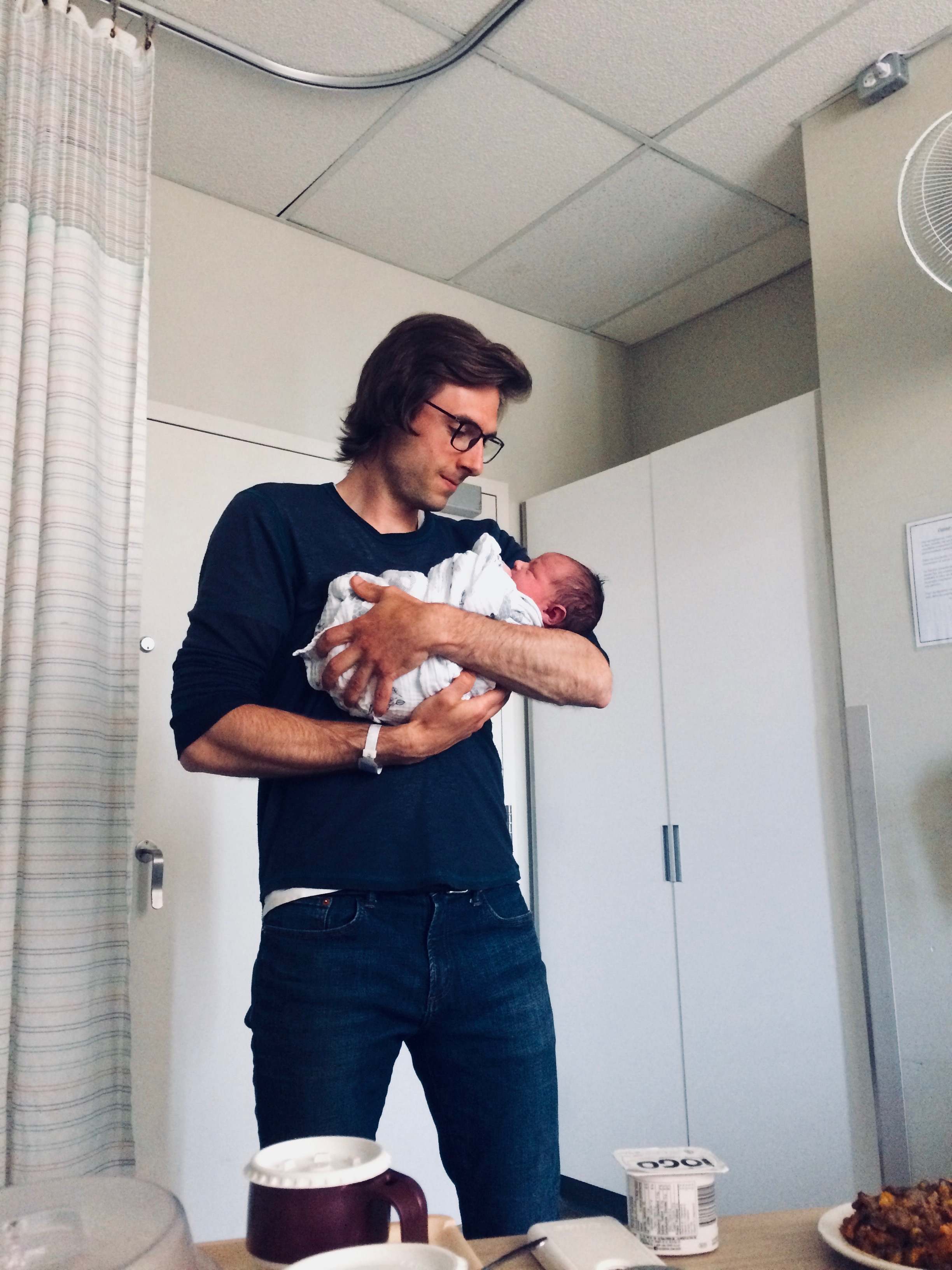 """One of the very first father-son moments! (and in the corner is a really yummy casserole friends prepared for us - thanks Jérémie & Audrey!! definitely way better than the """"beef surprise"""" hospital food. ;)"""