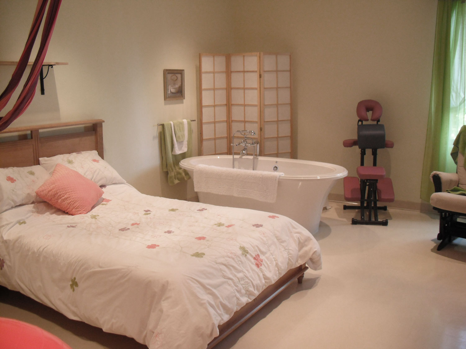 wouldn't you rather welcome your baby here? this is an example of a birthing center room - though this one is in a different town from us - couldn't find a pic on the net of ours! But they all look about like this. comfy bed, tub, homey, calming. the anti-hospital.