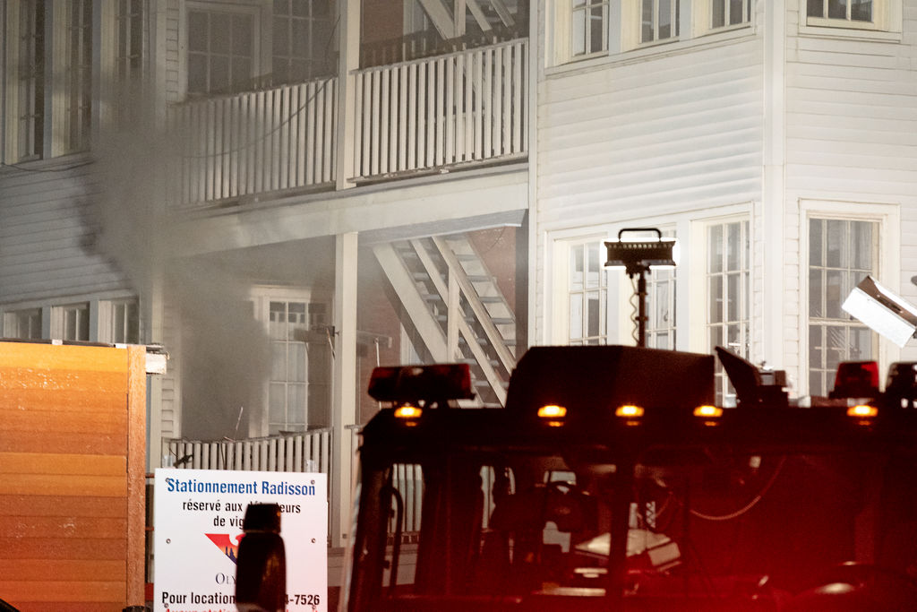 A view of the back of the building. Our apartment is on the right. Smoke escapes from the apartment on the left, which is on our floor, across the hall, and the only other apartment aside from the source apartment to suffer extensive damage.