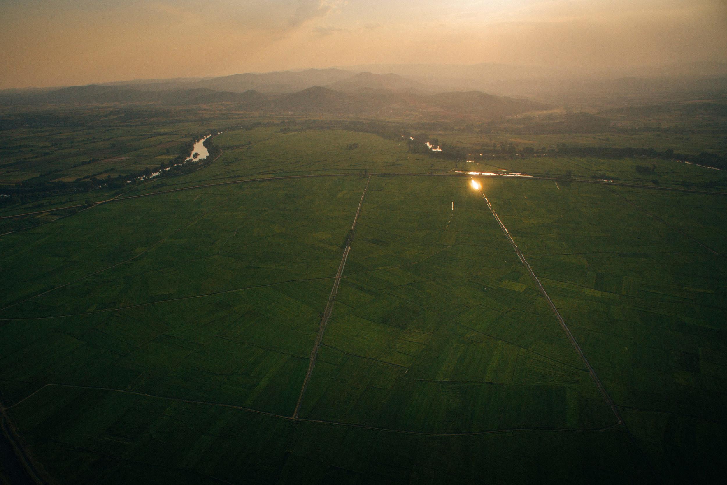 Sunset over green fields