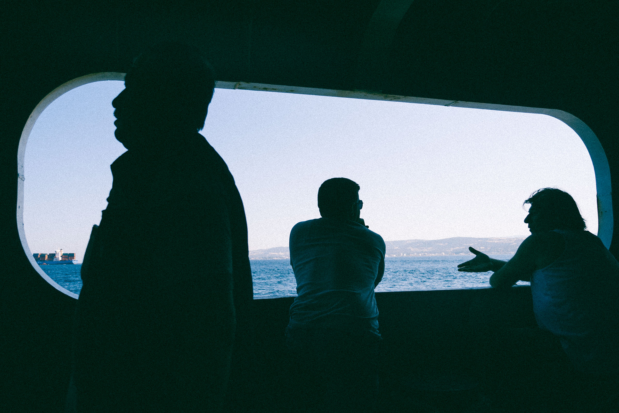 Men chatting on a ferry