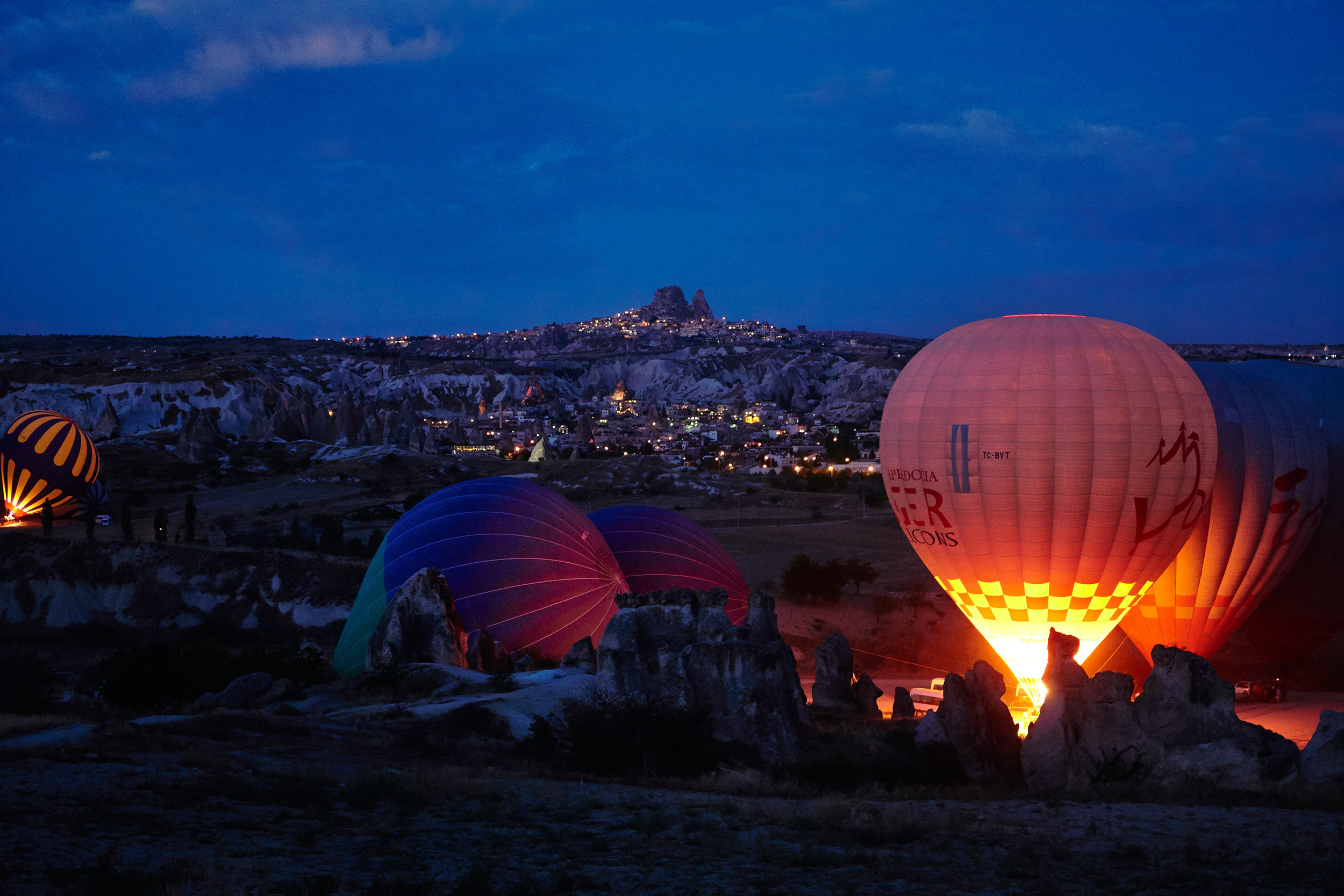 Cappadocia balloons with Uchisar and Goreme in the background