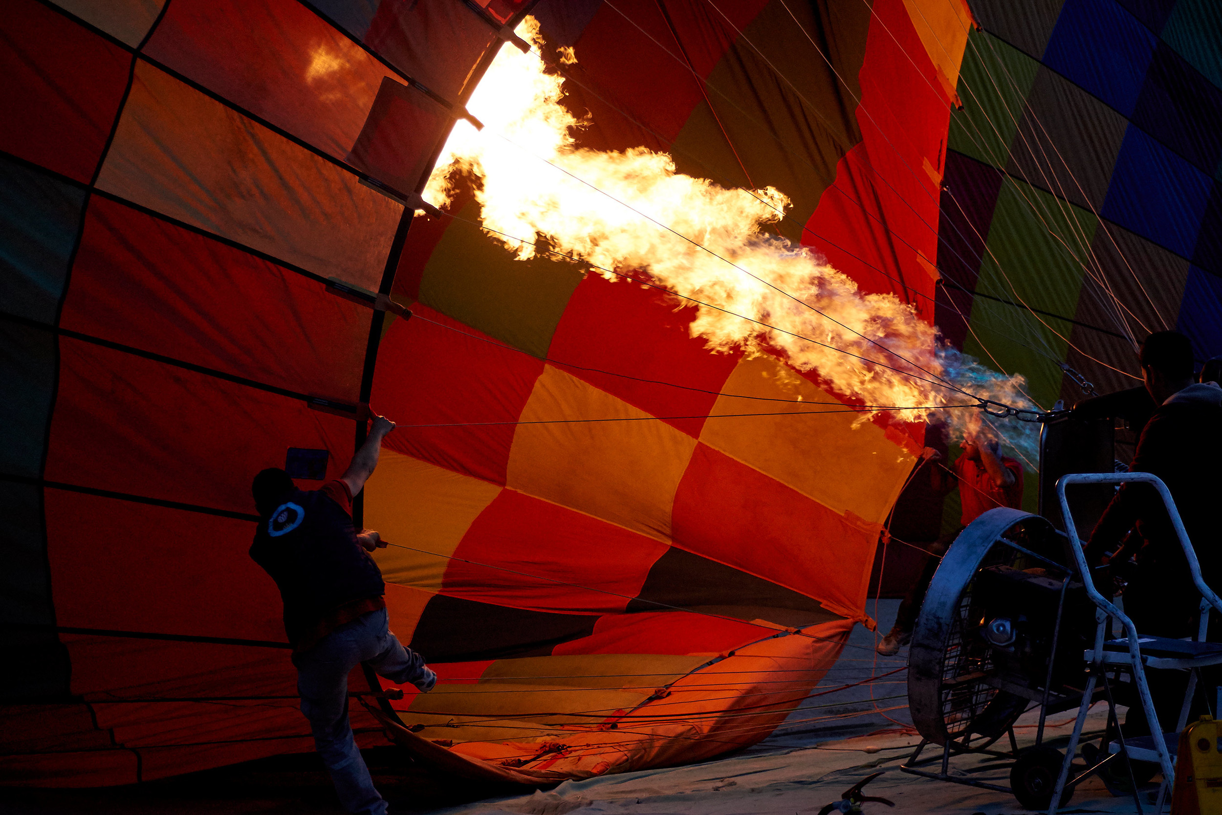 Man filling balloon with hot air, Cappadocia