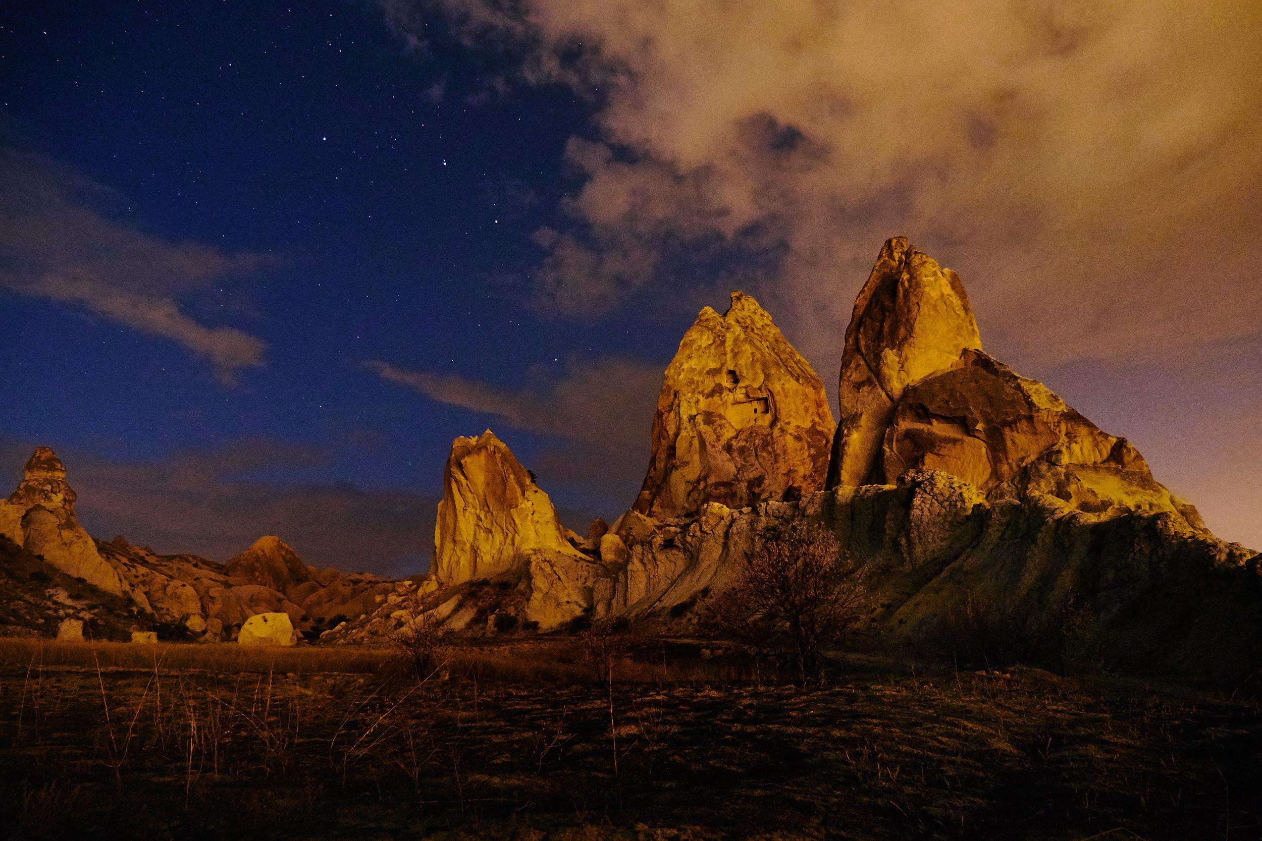 Triangular rock formations at night, Cappadocia