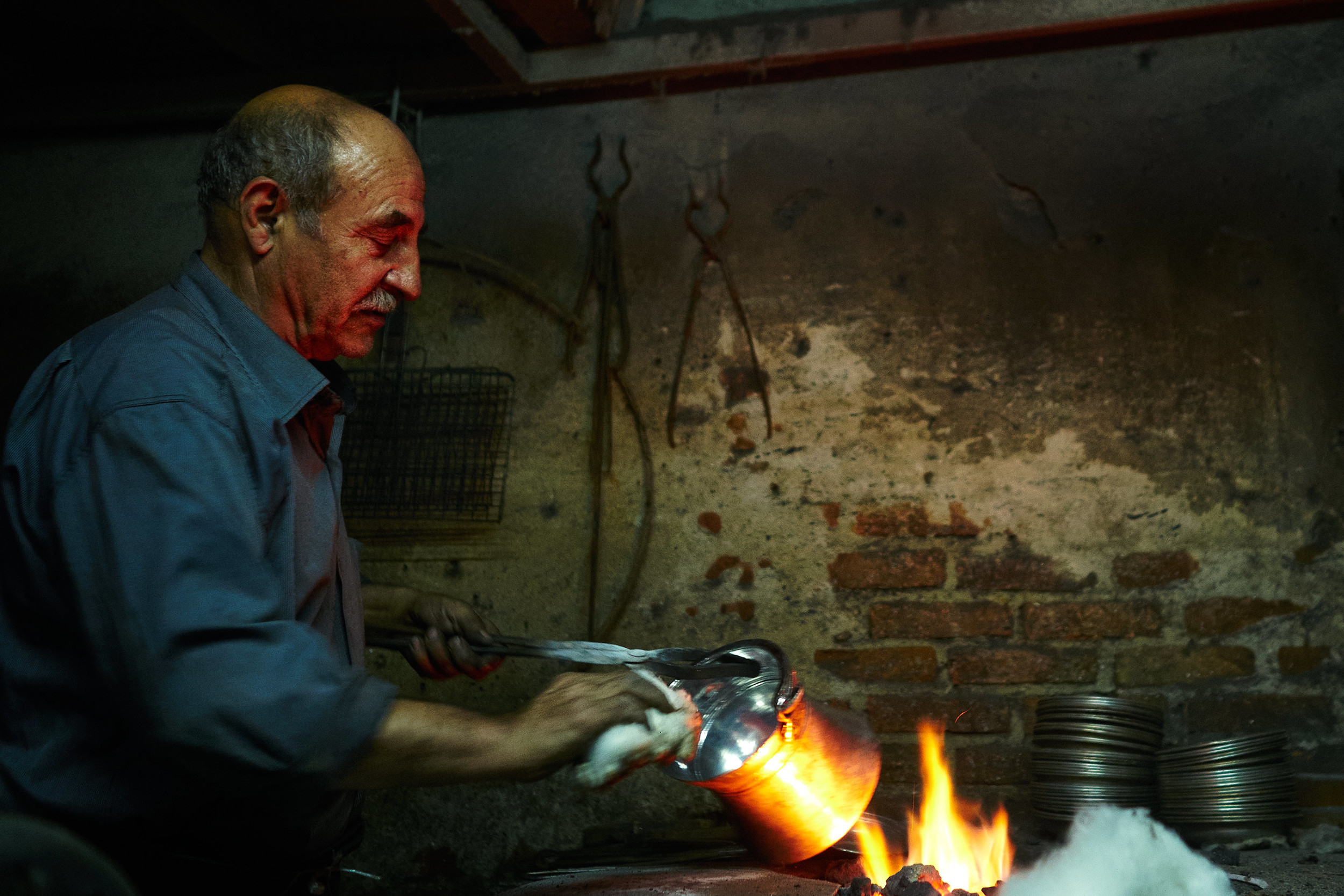Man working on a metal pot, Malatya, Turkey