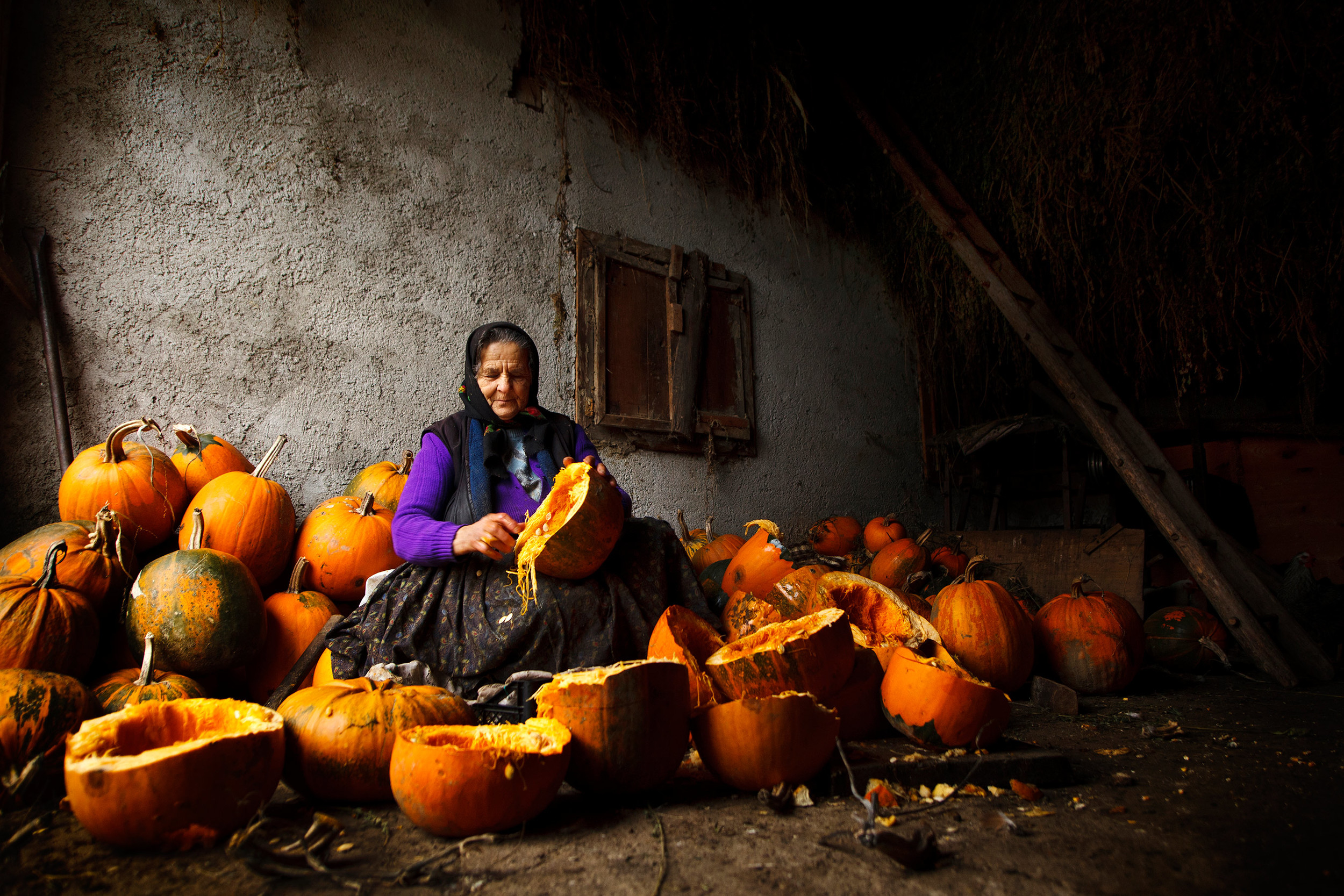Romanian woman with pumpkins