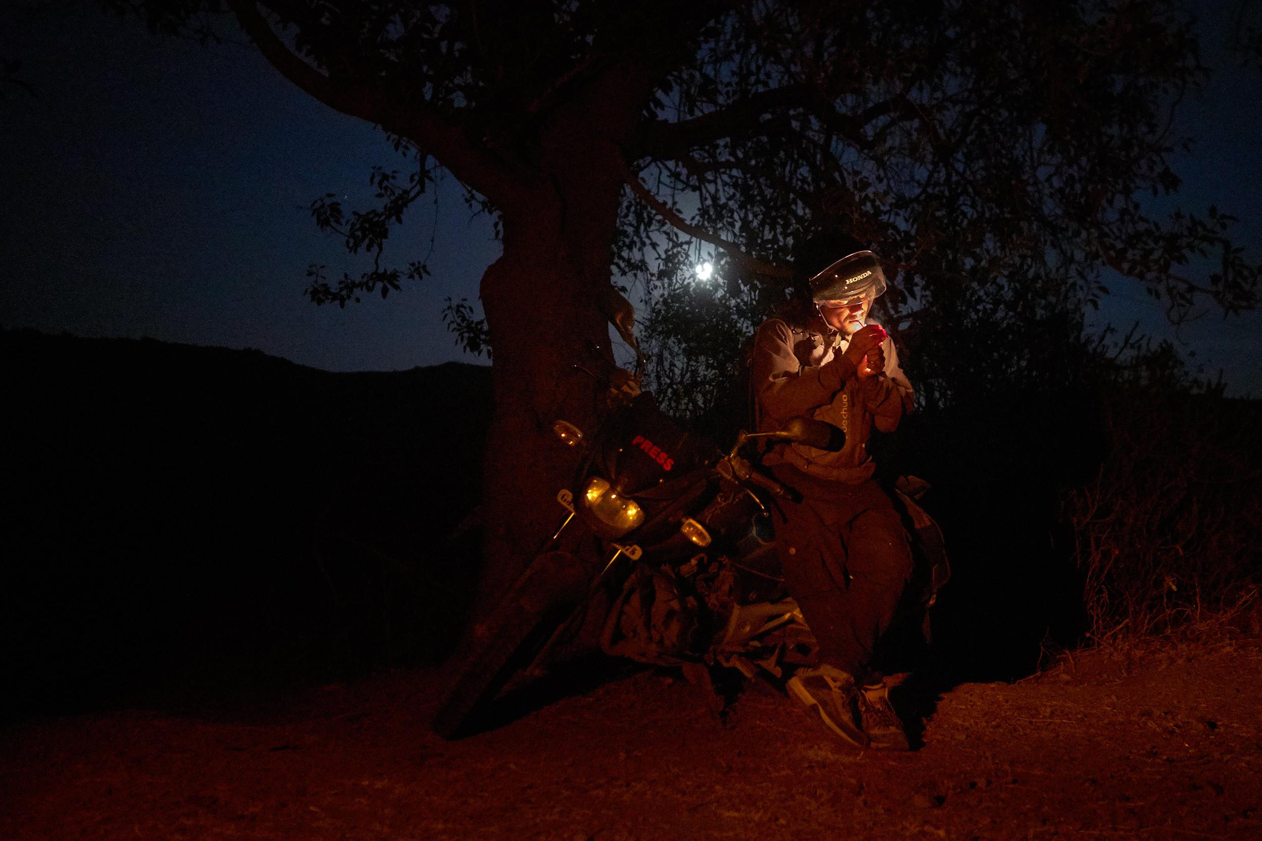 Lighting up under a tree in Gujarat