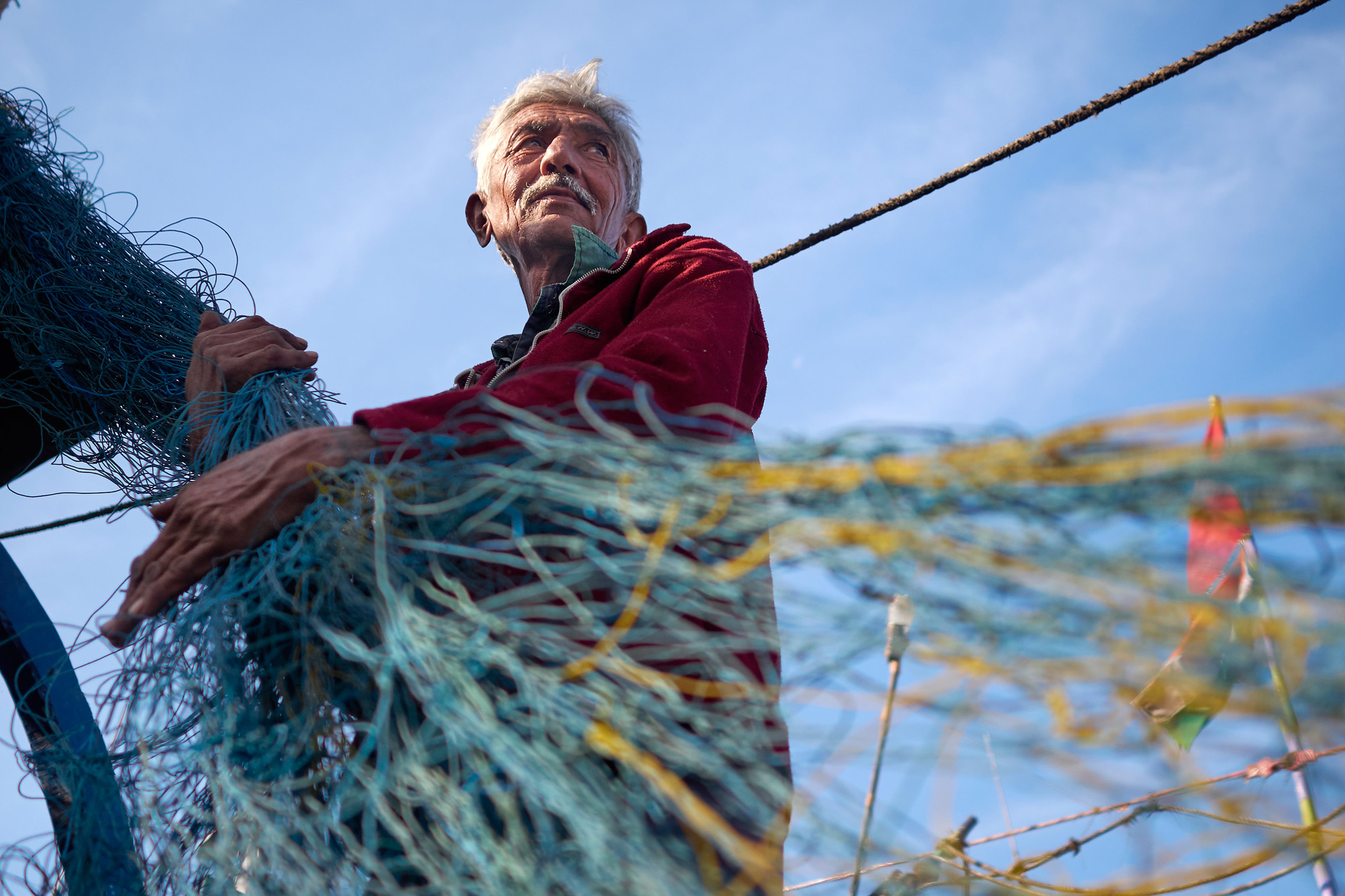 Fisherman packing up the net