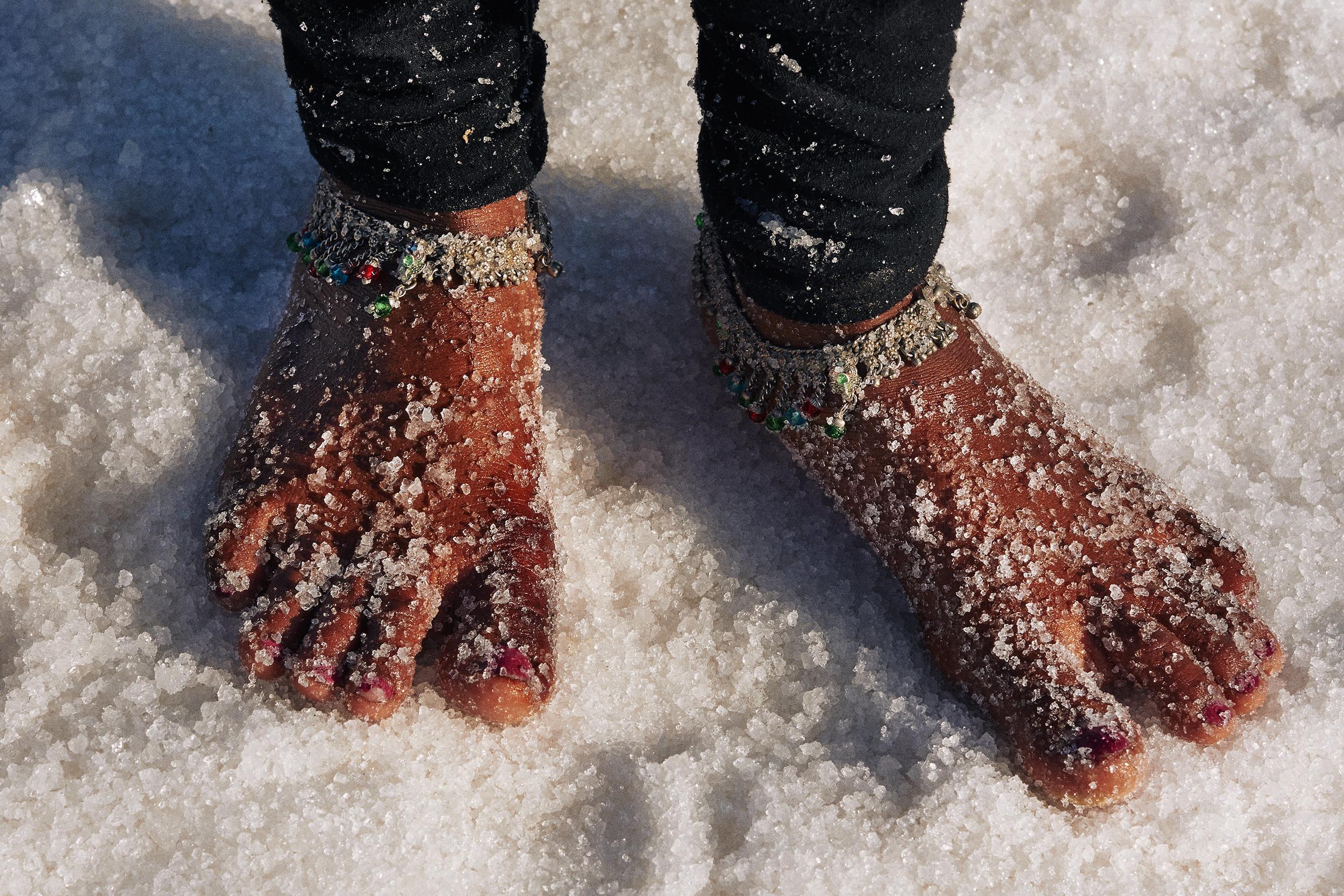 Feet of a girl salt-worker
