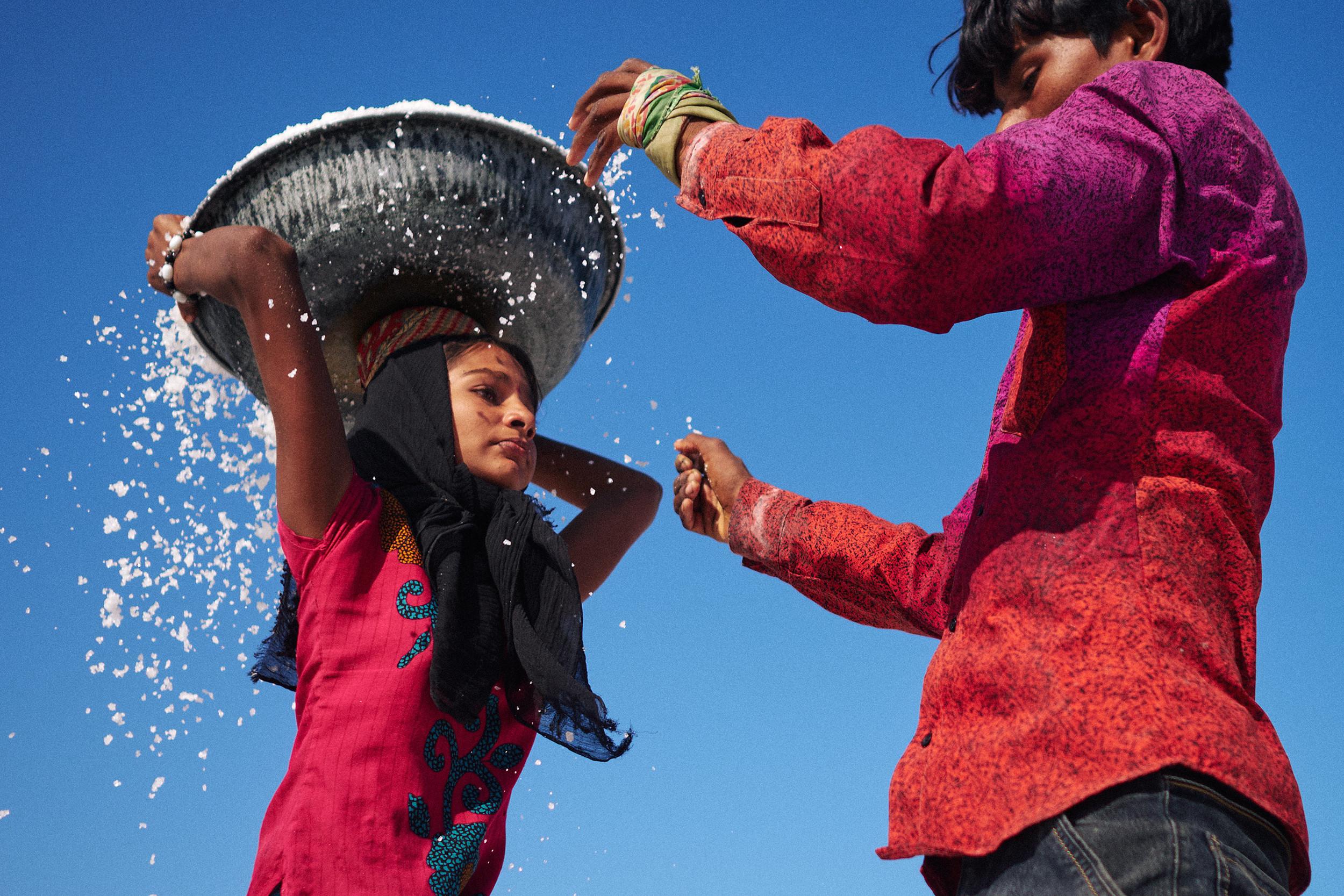 Girl salt-worker with a tub of salt on her head