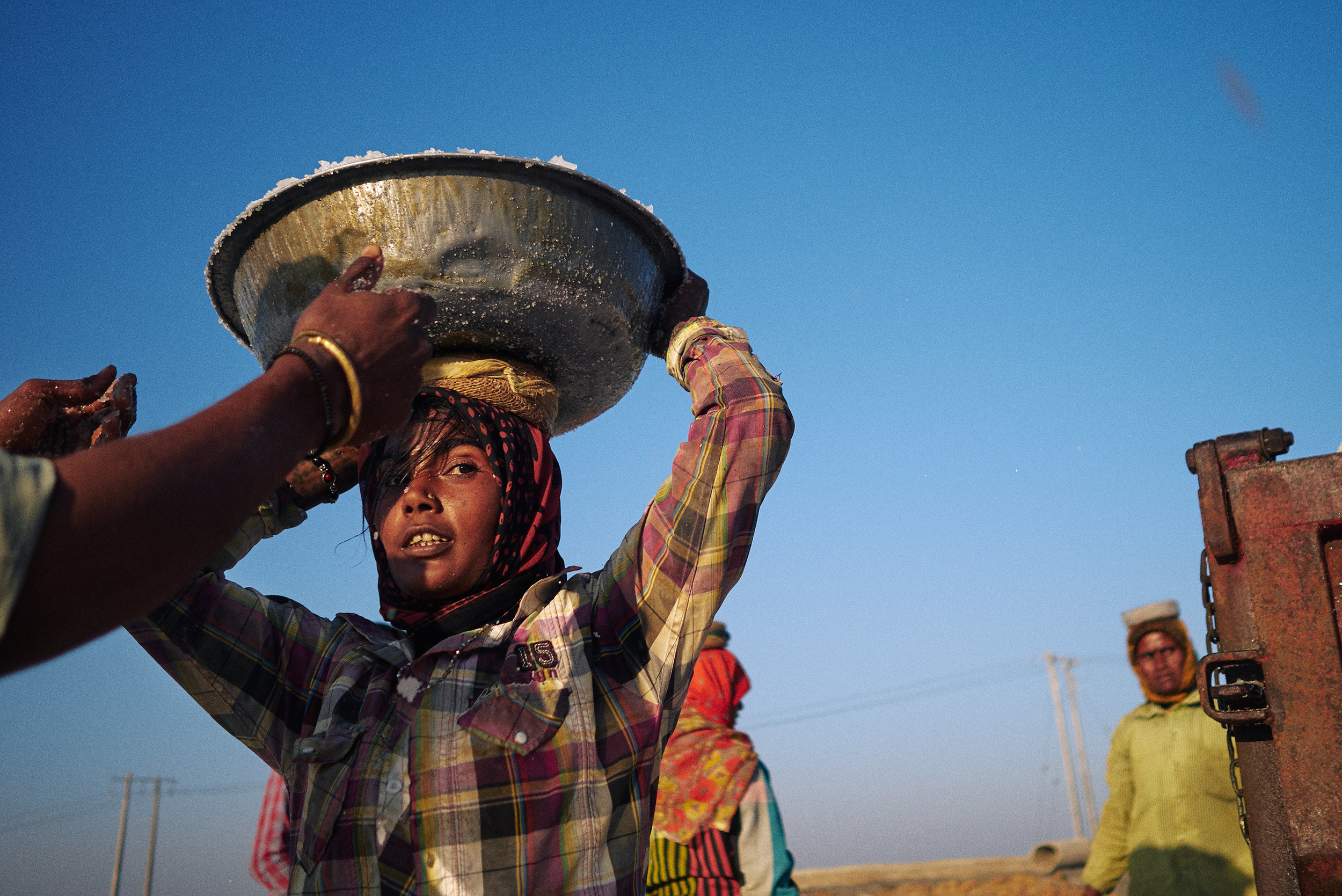 Woman with a loaded basin over her head