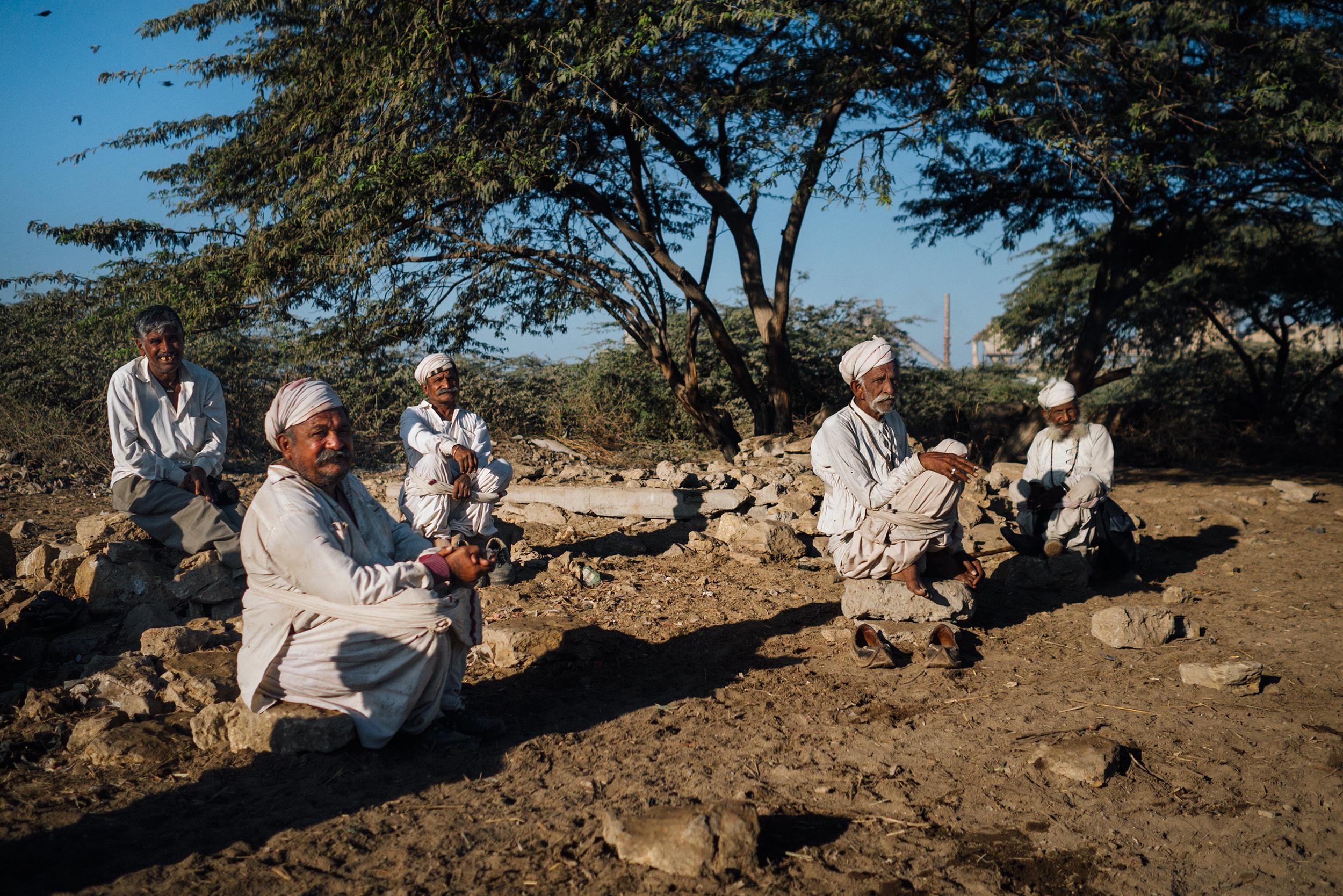 Village men sitting around