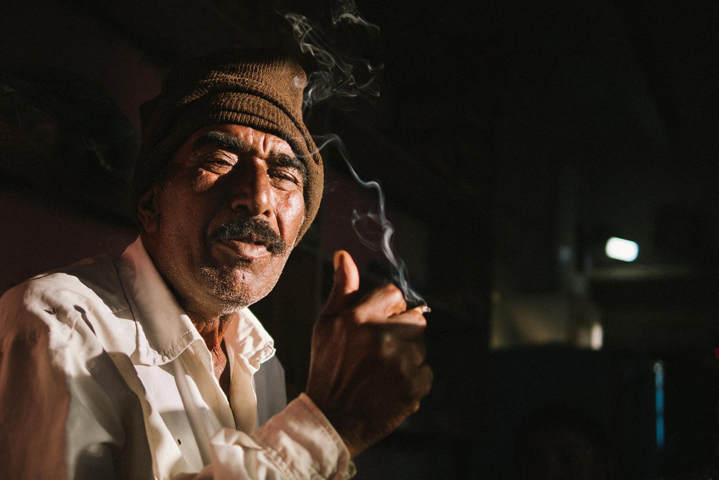 Man smoking in his shop