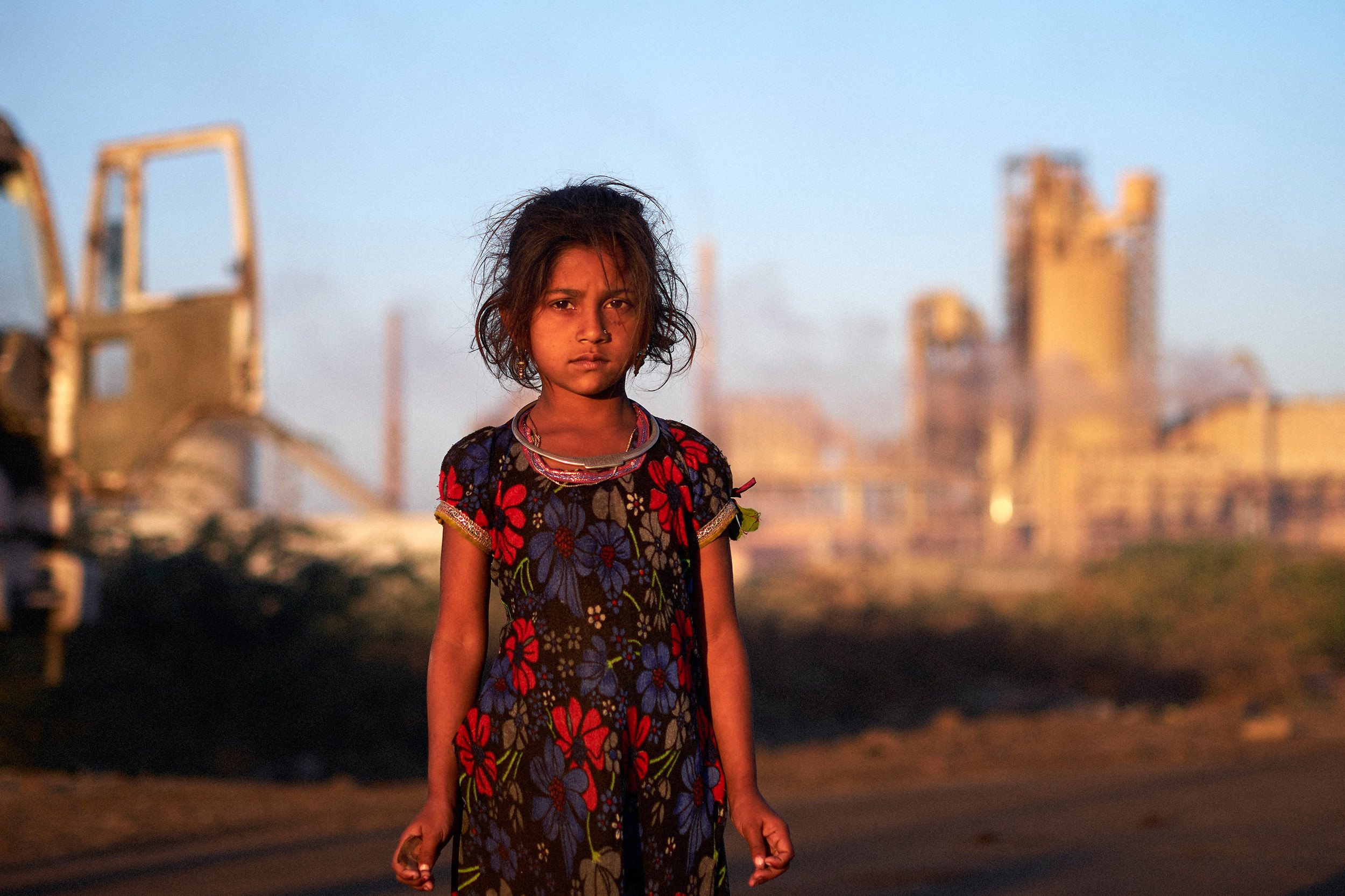Girl in front of the chemical plant
