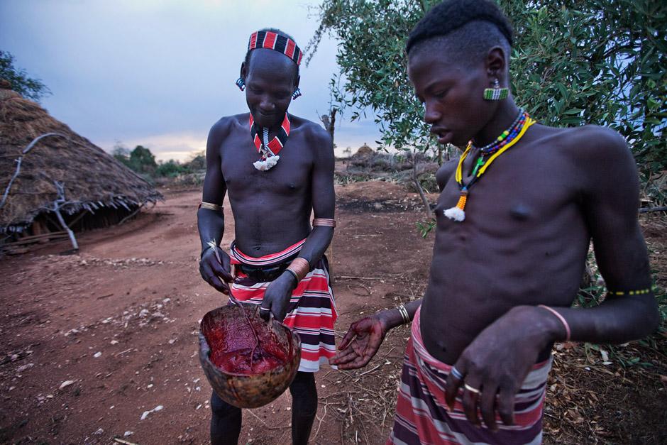 Hamer men getting ready to drink goat blood