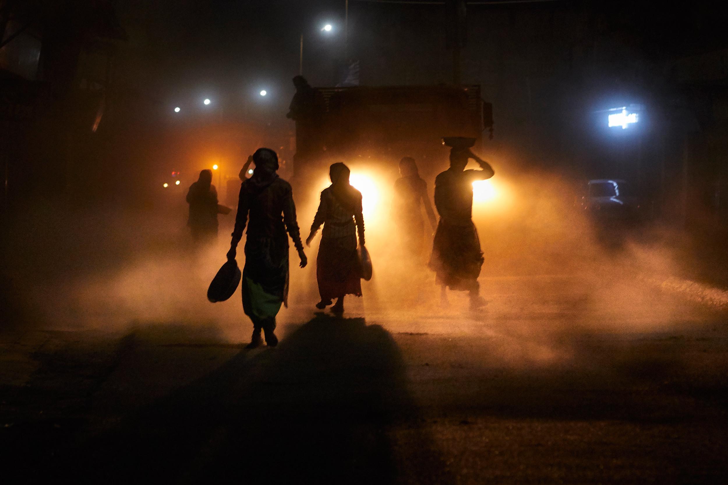 Women road workers walking towards a truck