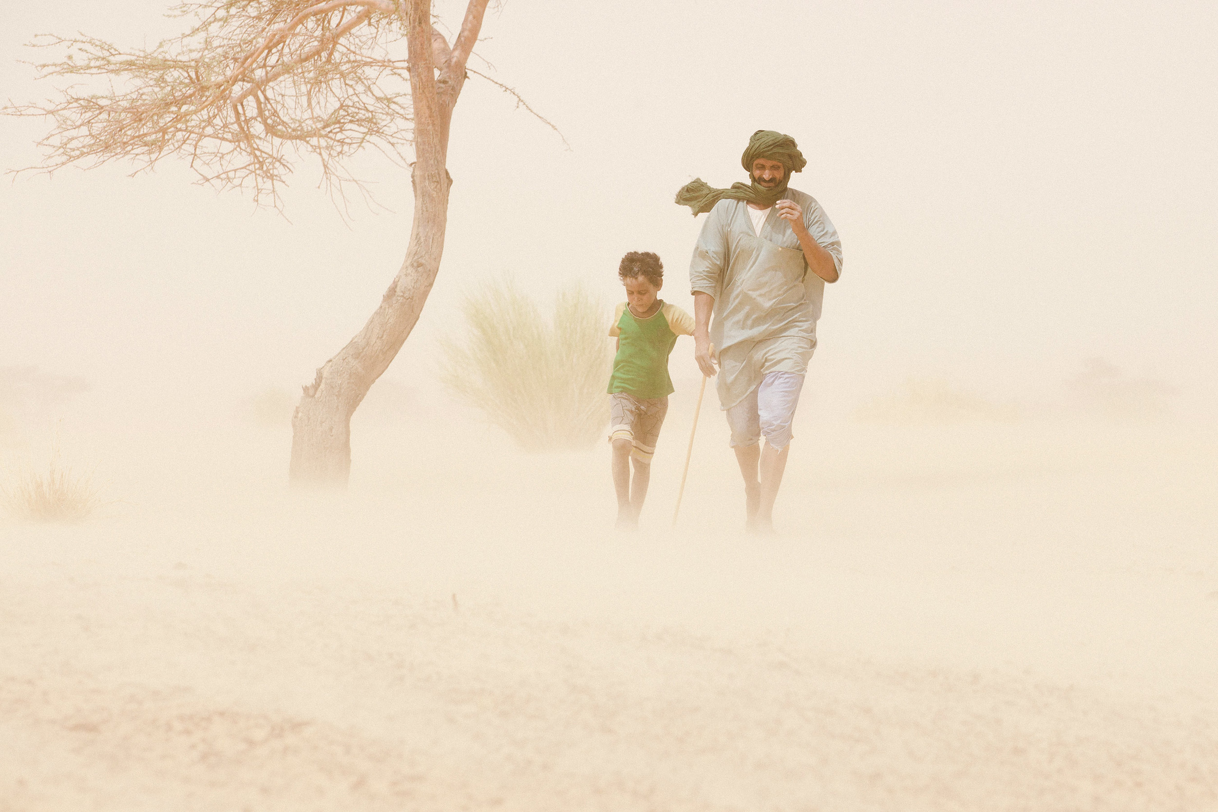 Father and son in a sand storm