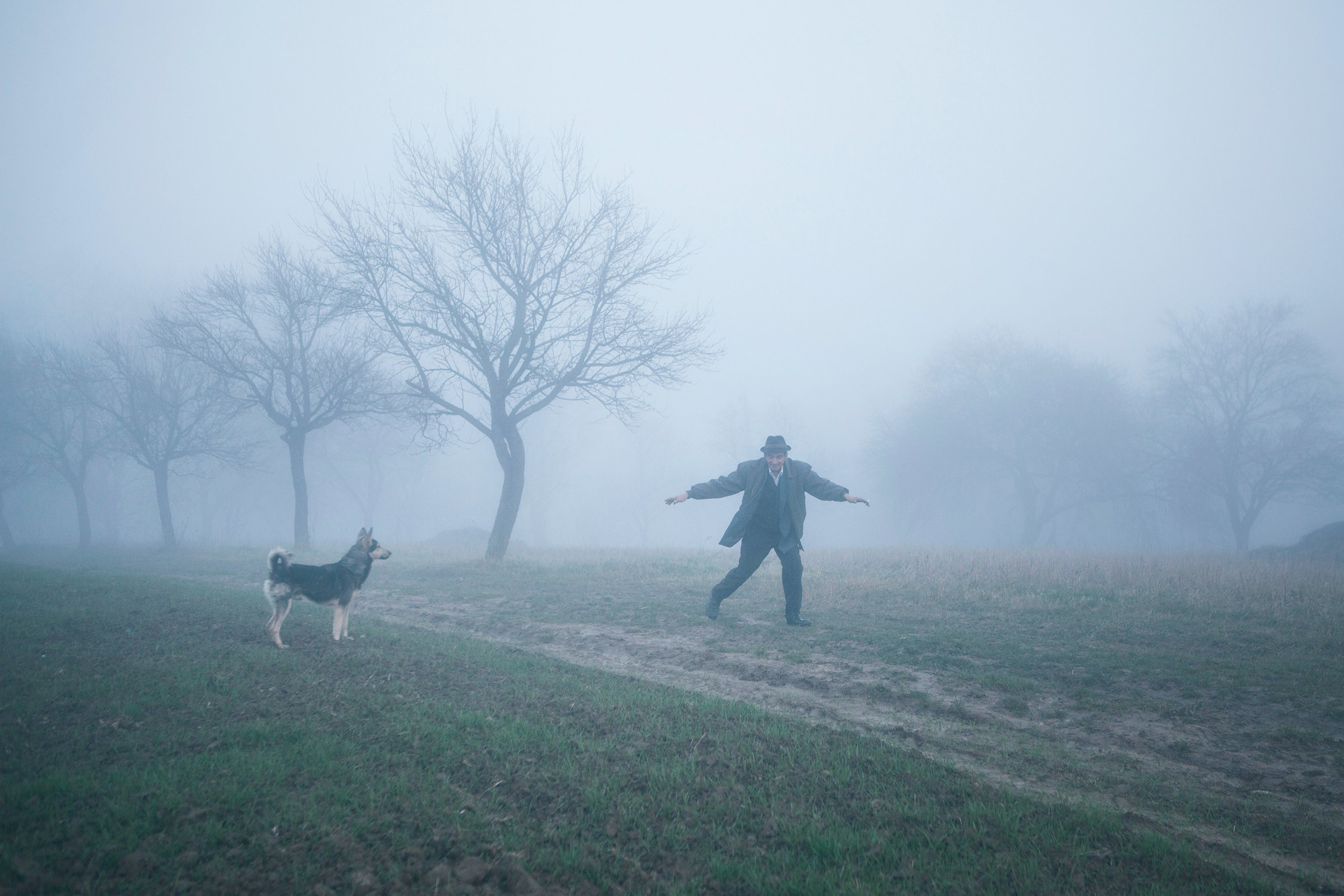 Romanian man chasing his dog in the fog