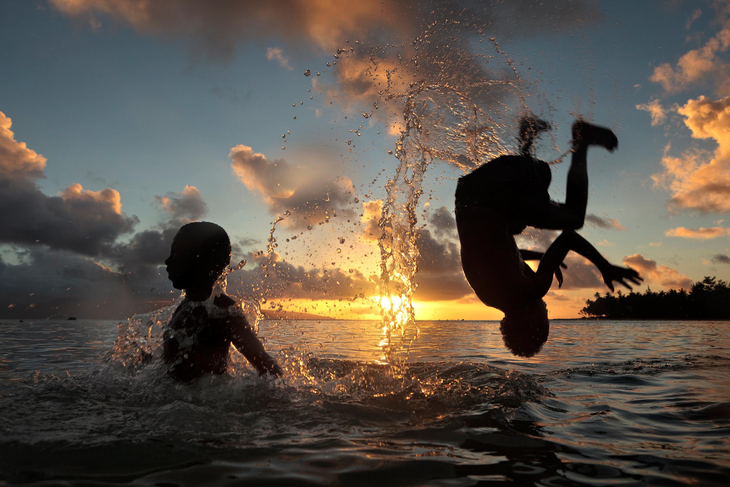 Children playing in a lagoon in Vanuatu