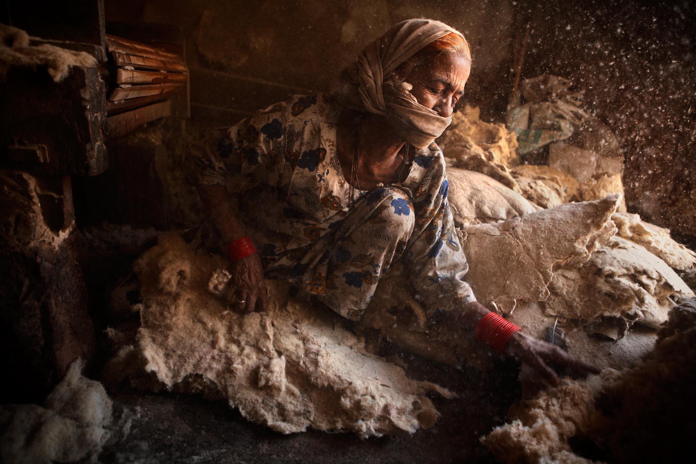 Rajasthani woman in a mattress factory