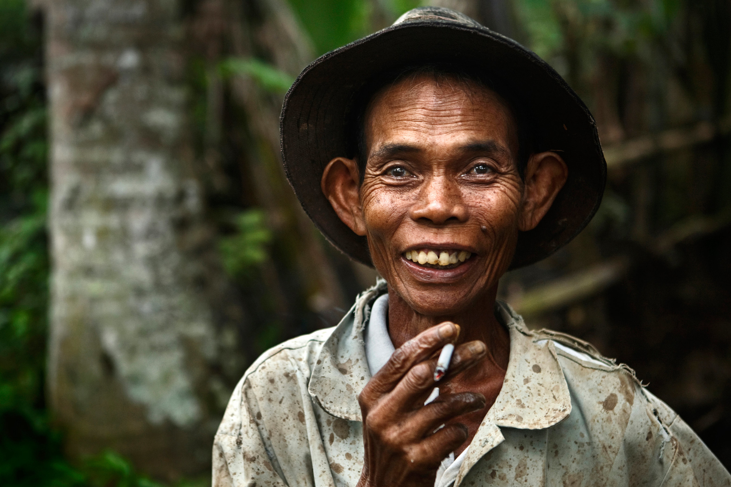 Javanese farmer smiling and smoking