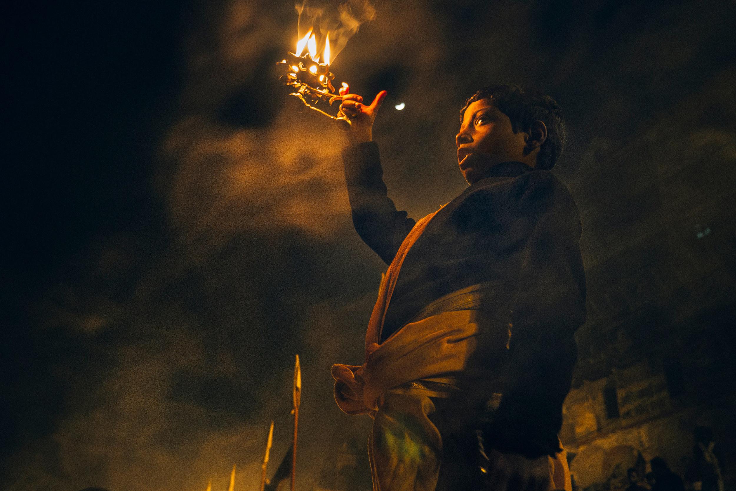 Young boy practicing Ganga Aarti
