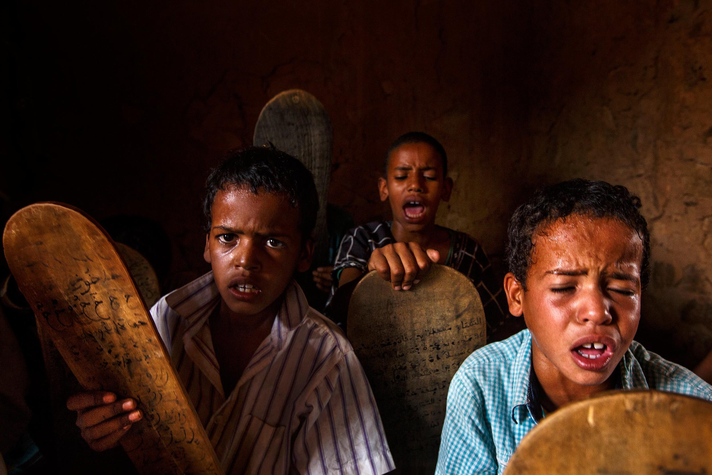 Children reciting the Q'ran in a Mahadara in Mauritania