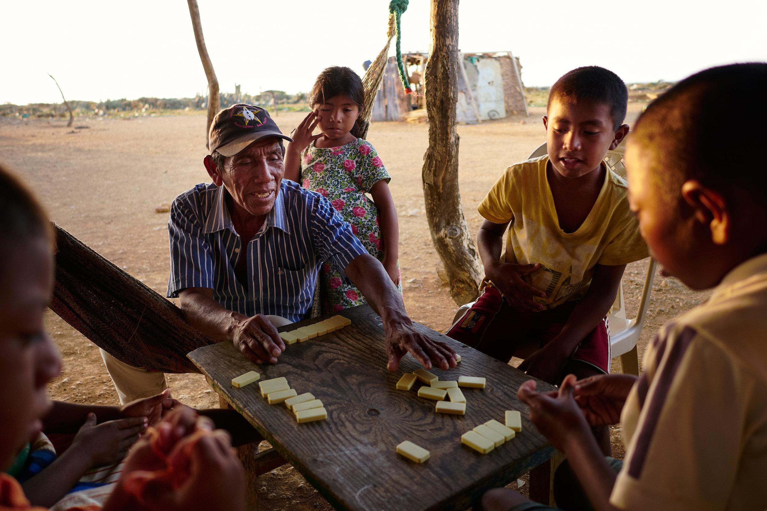 Wayuu villagers playing dominos