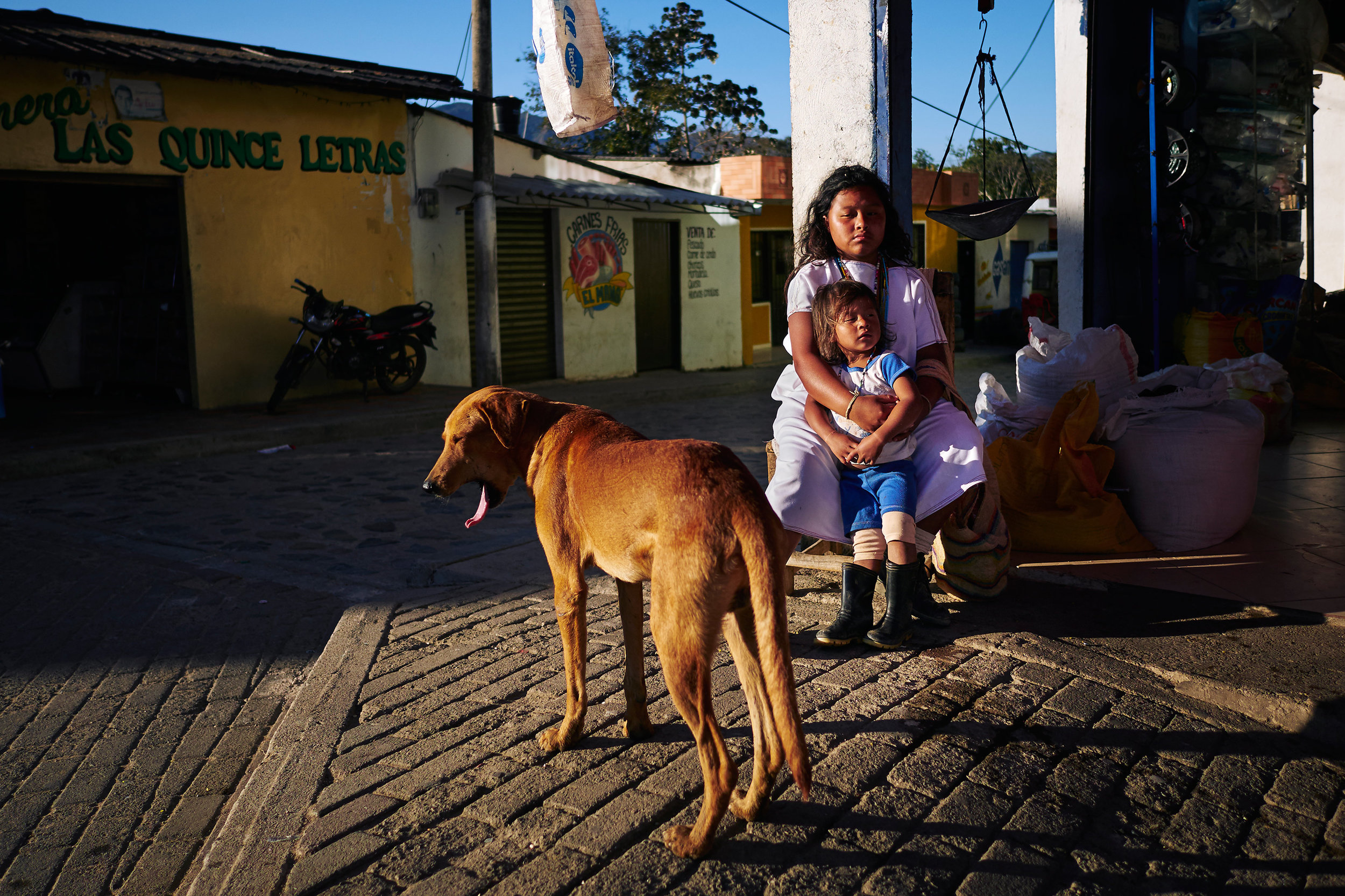 Arhuaco children waiting on the street of Pueblo Bello.