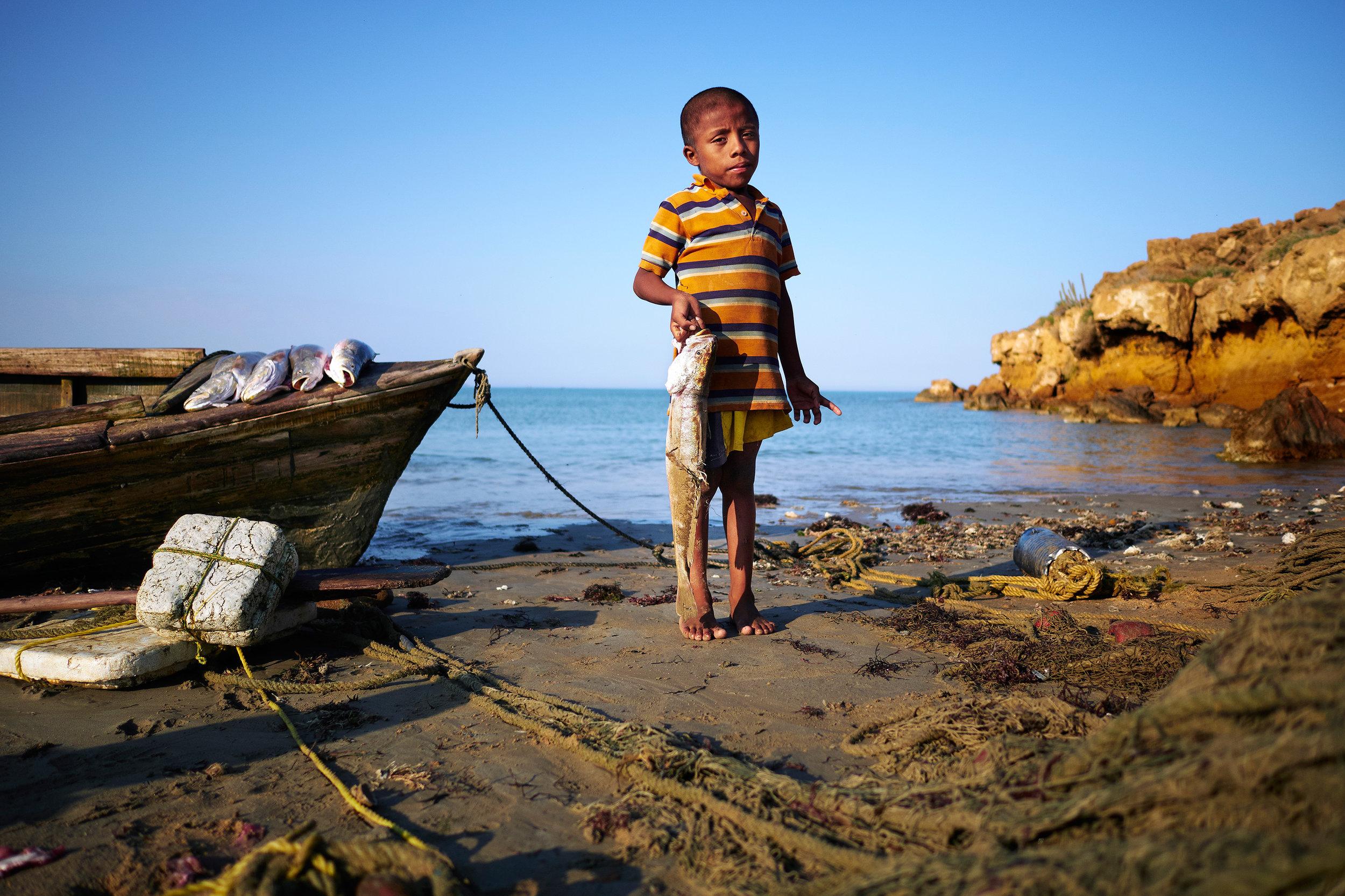 Wayuu boy with fish