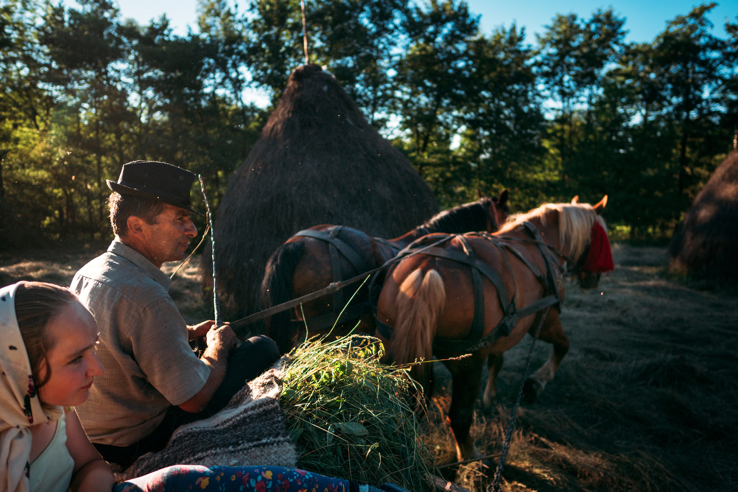 Maramure-Romania-father-and-daughter-on-horse-cart