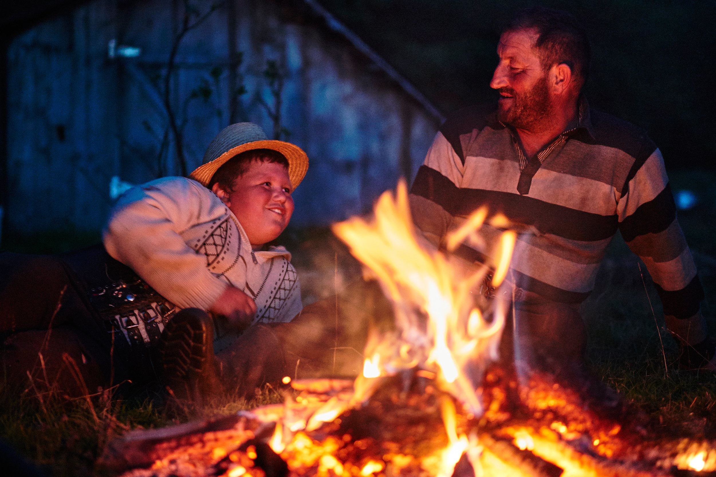 Maramures-Romania-boy-and-his-uncle-by-the-fire