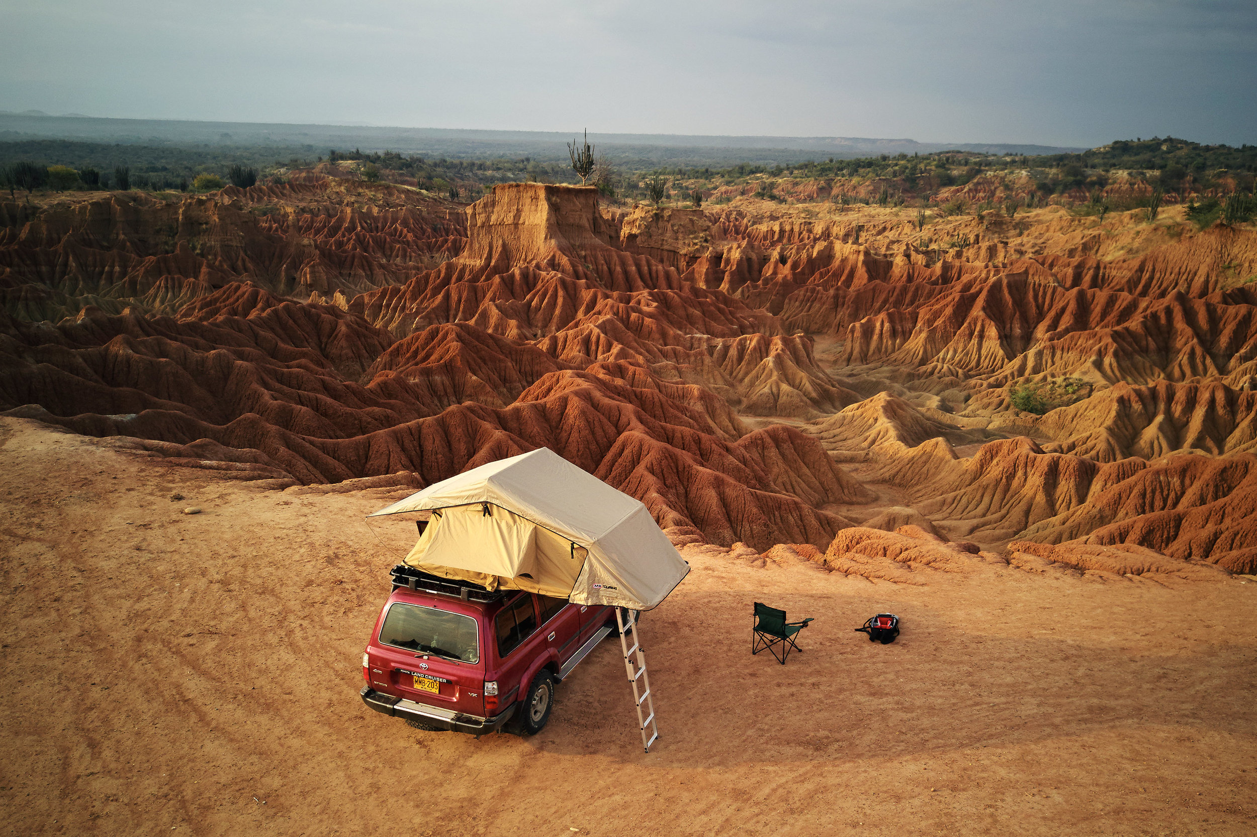 Car with rooftop tent in Tatacoa desert Colombia