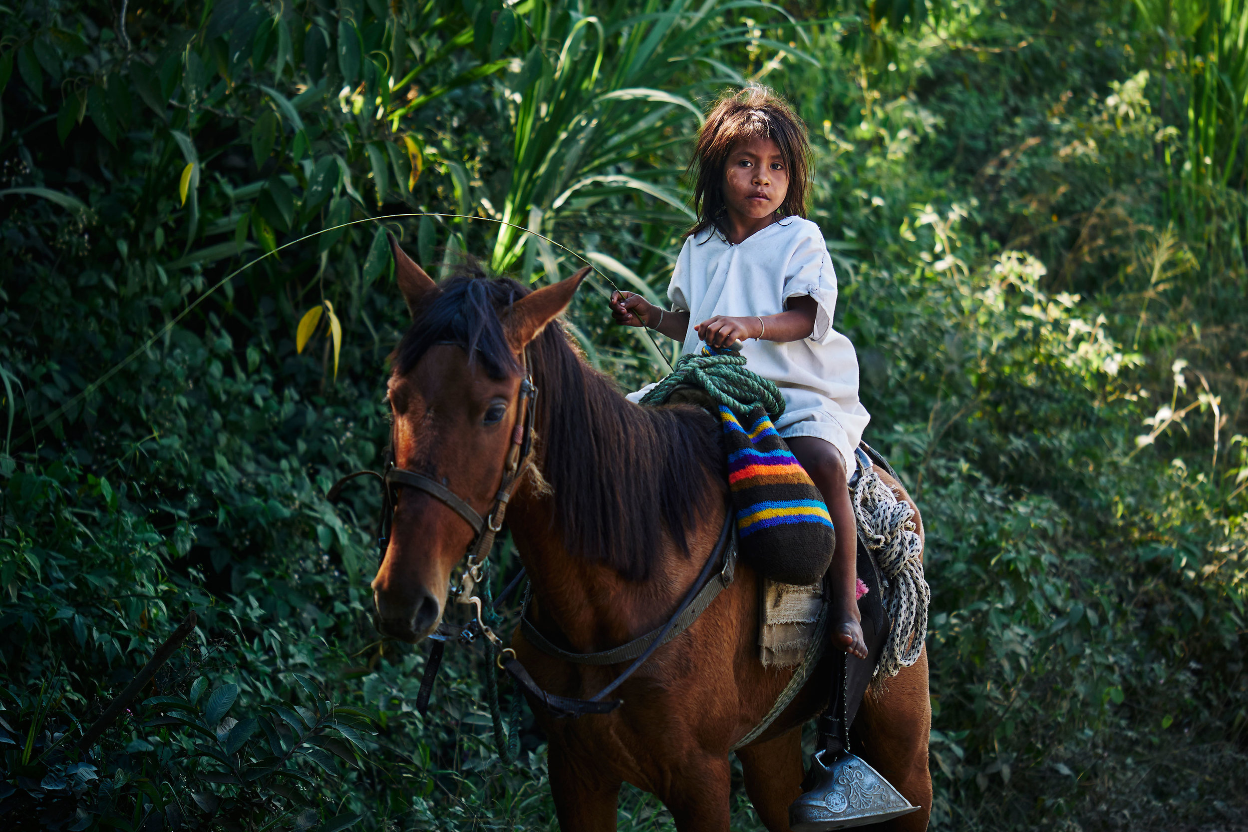 Colombia-travel-Pueblo-Bello-Arhuaco-boy-on-horse