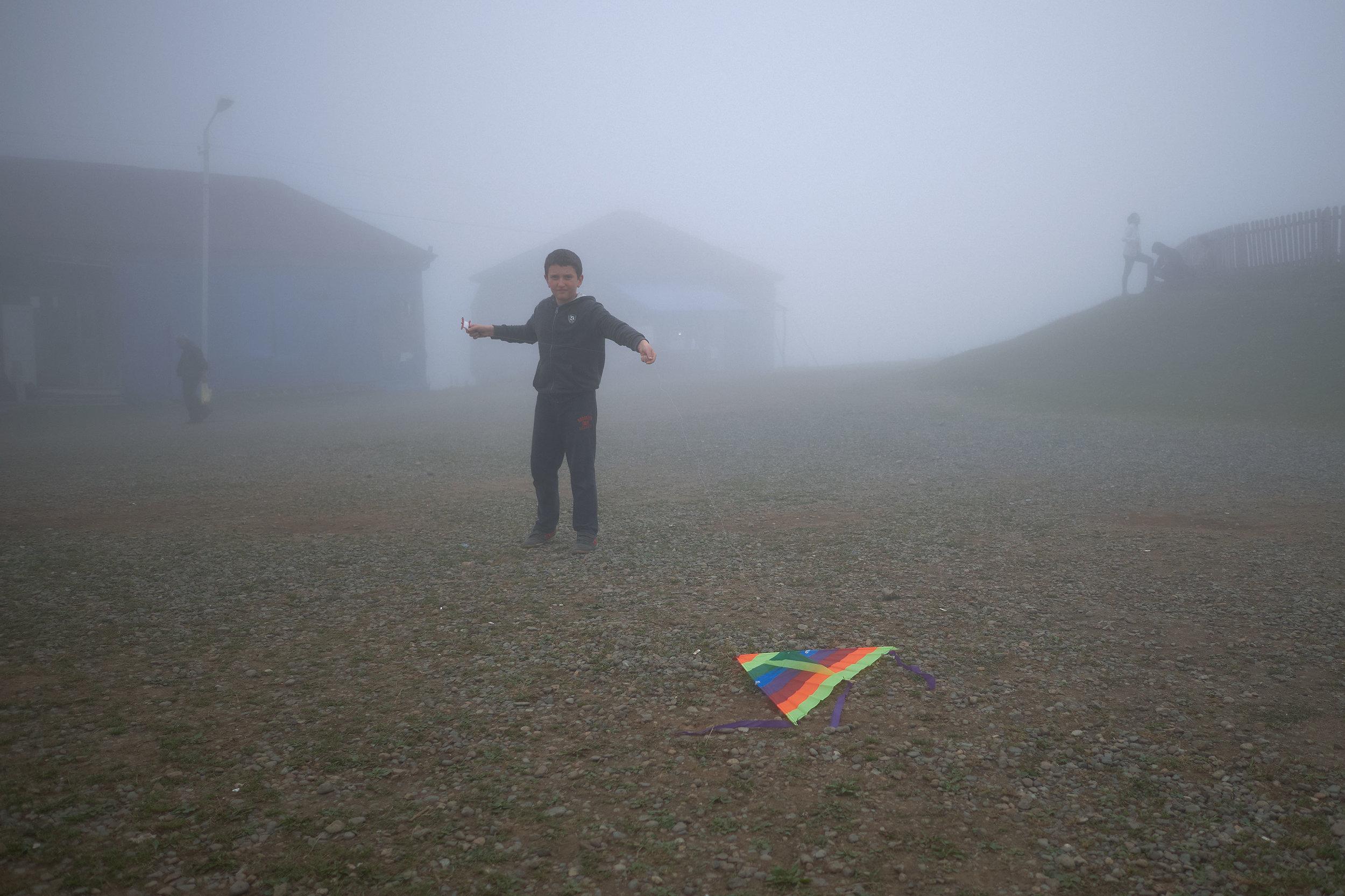 Bakhmaro-Georgia-boy-with-kite