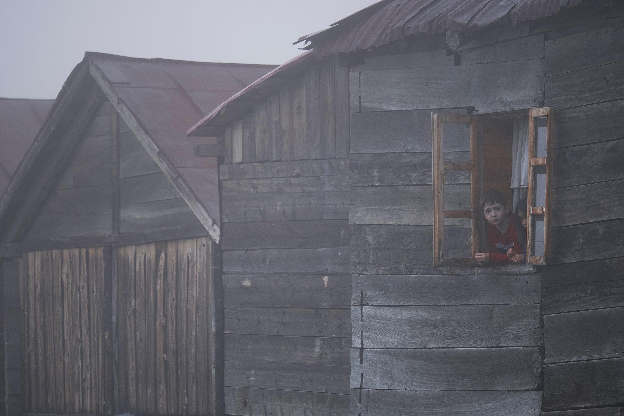 Bakhmaro-Georgia-boy-in-a-wooden-house