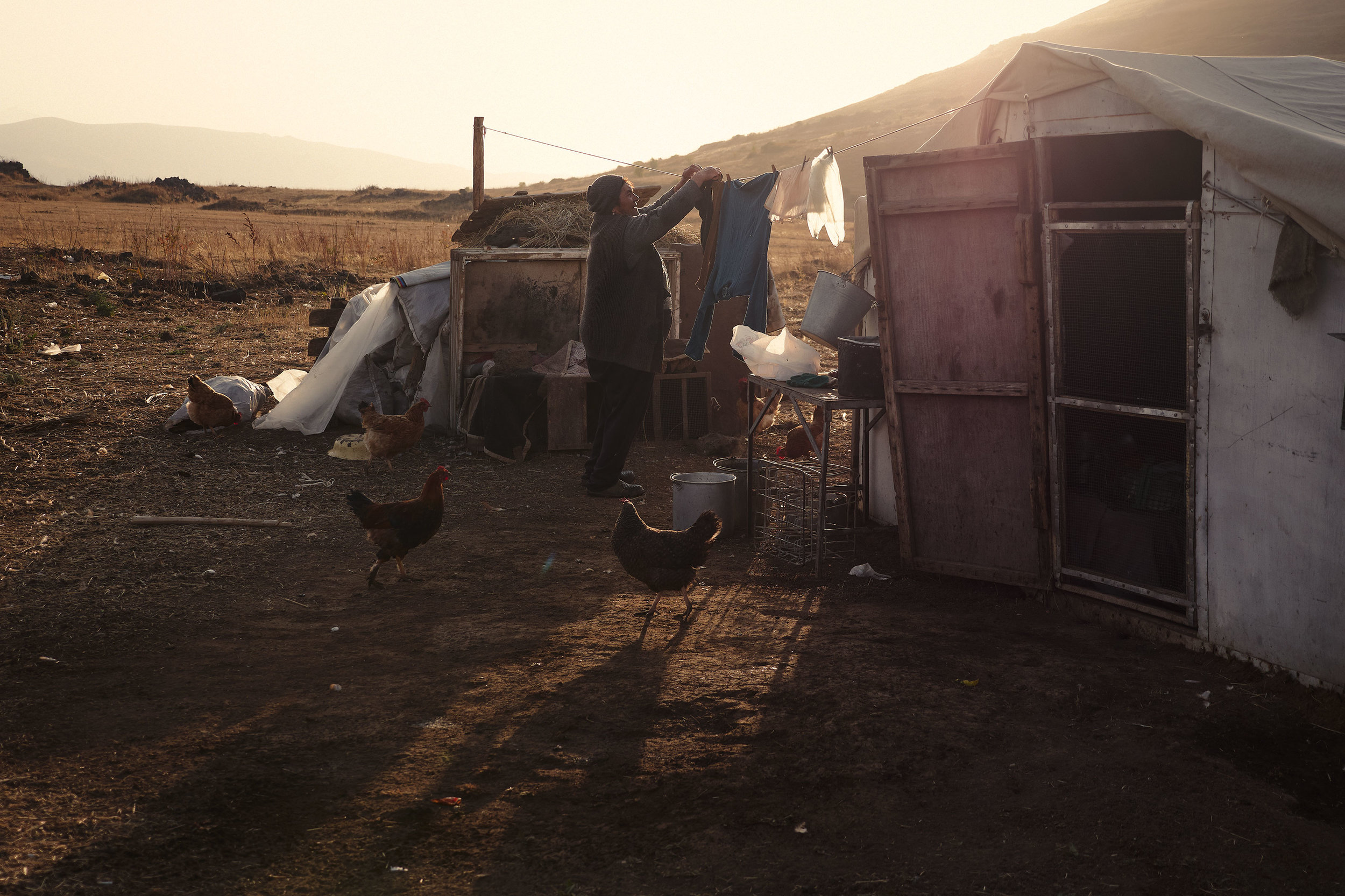 Armenia-Vayots-Sar-woman-hanging-laundry
