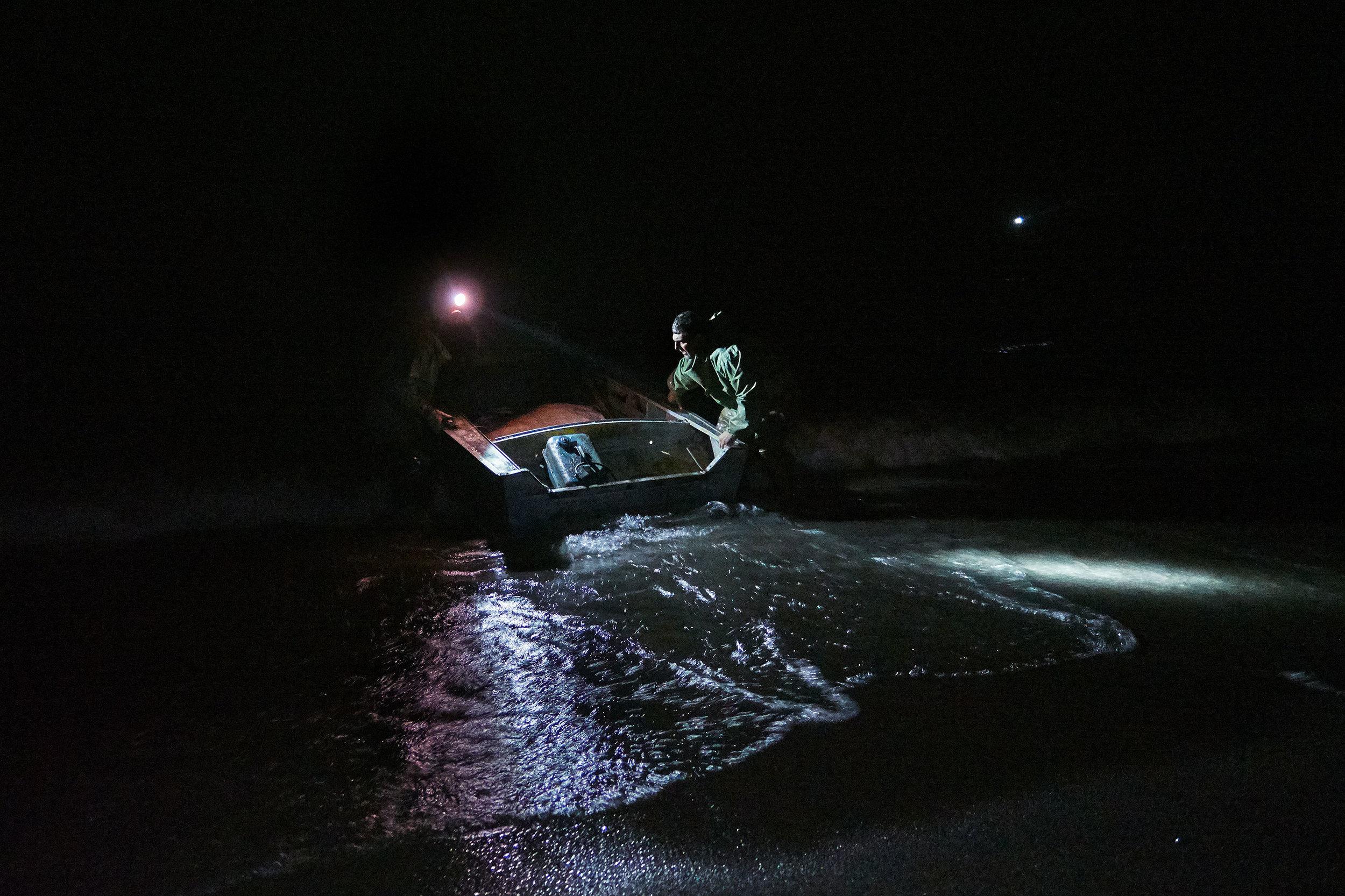 Armenia-Lake-Sevan-fisherman-pulling-out-boat.JPG