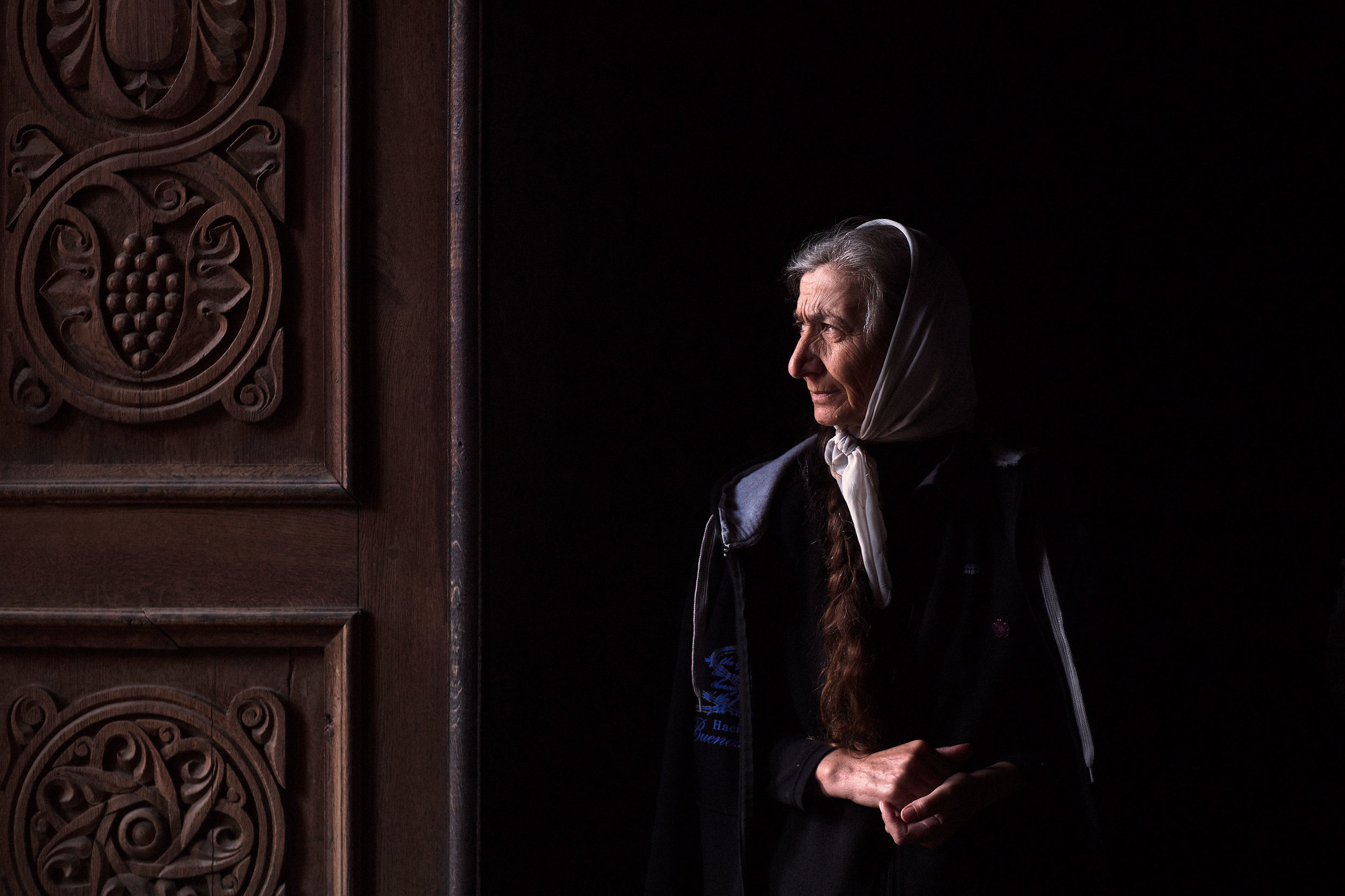 Armenia,-Tatev-monastery-woman-by-the-church-door
