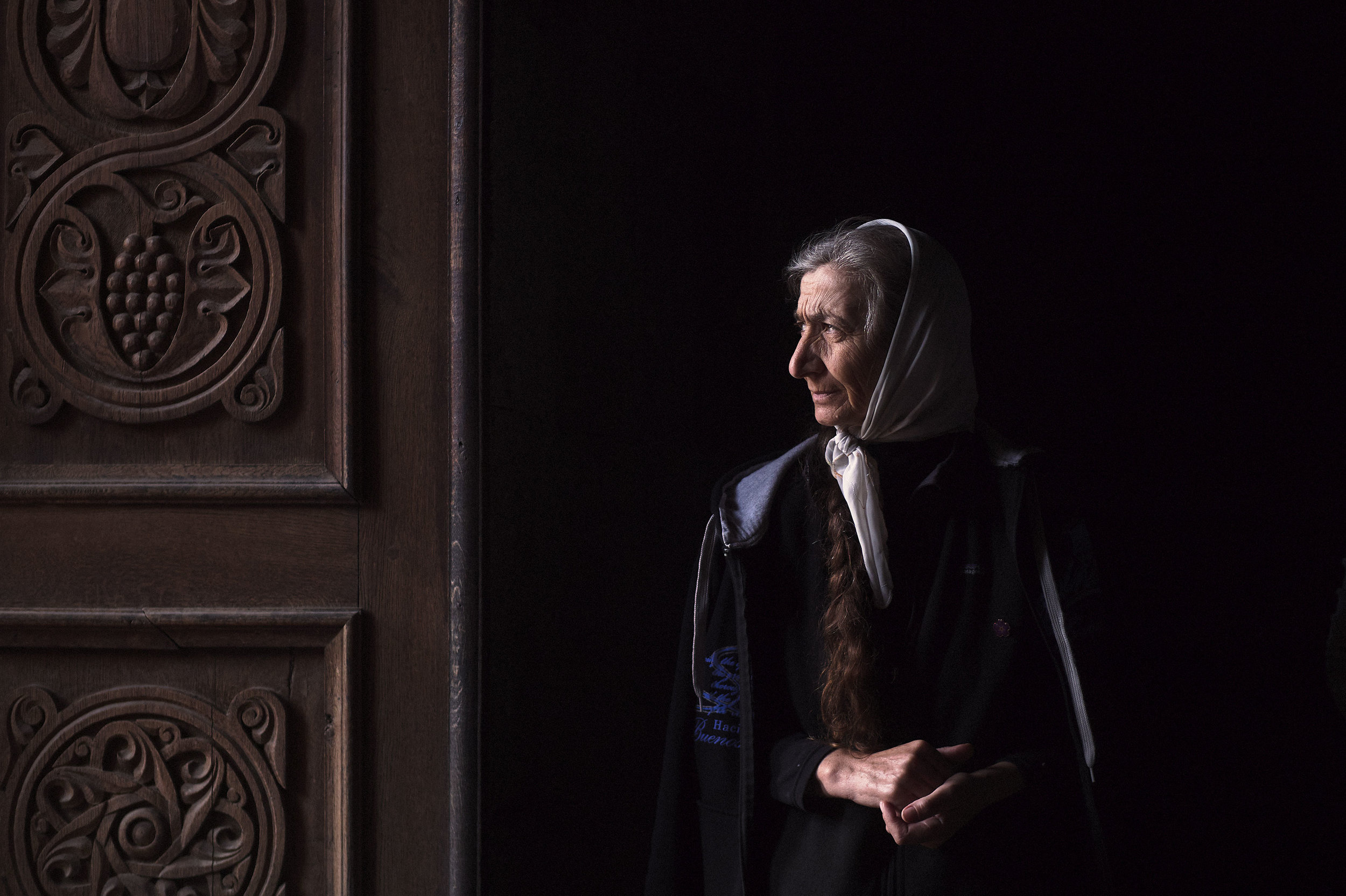 Armenia,-Tatev-monastery---woman-by-the-church-door_1144784.jpg