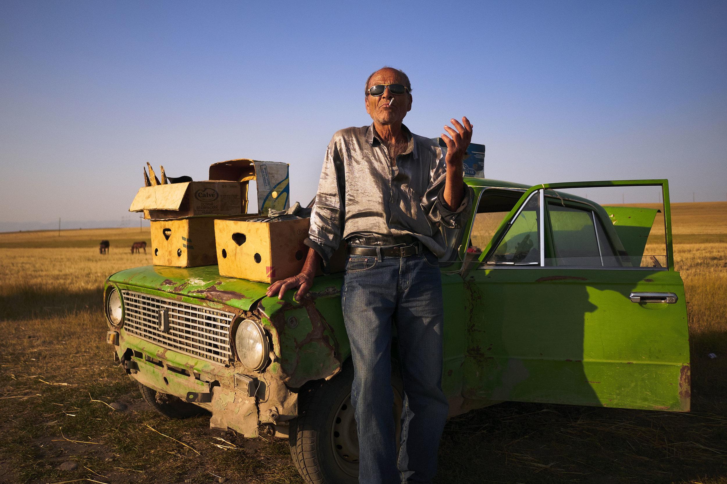 Armenia-man-selling-dry-fish-Lada-Soviet-car