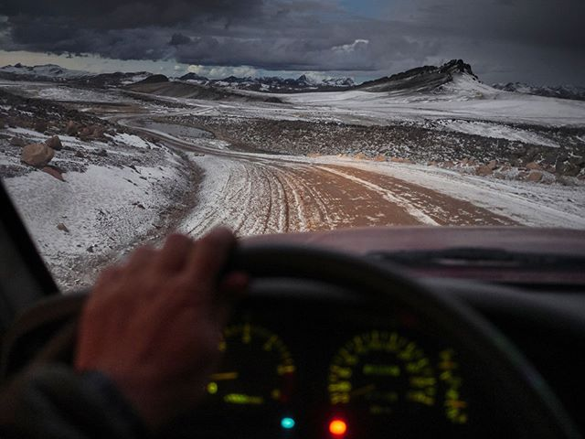 A mountain pass over 5000 meters. Sun going down. Snow about to start falling hard. Fuel running low. I was hoping I could reflect on it all and say what a great adventure it was. Probably one of the more sketchy situations I've ever found myself in as far as driving goes.  #Peru #Andes #dusk #bluehour #mountainpass #view #insidecar #snowpeak #travelphotography #travelphotographer #adventure #driving #mountains #Panasonic #GX80 #Lumix #cold #altitude